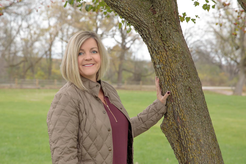 female_headshot_on_location_trimborn_farm_tree.jpg