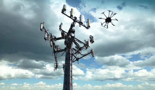 A drone hovers near an AT&T cellular tower for an inspection. (Credit: AT&T)