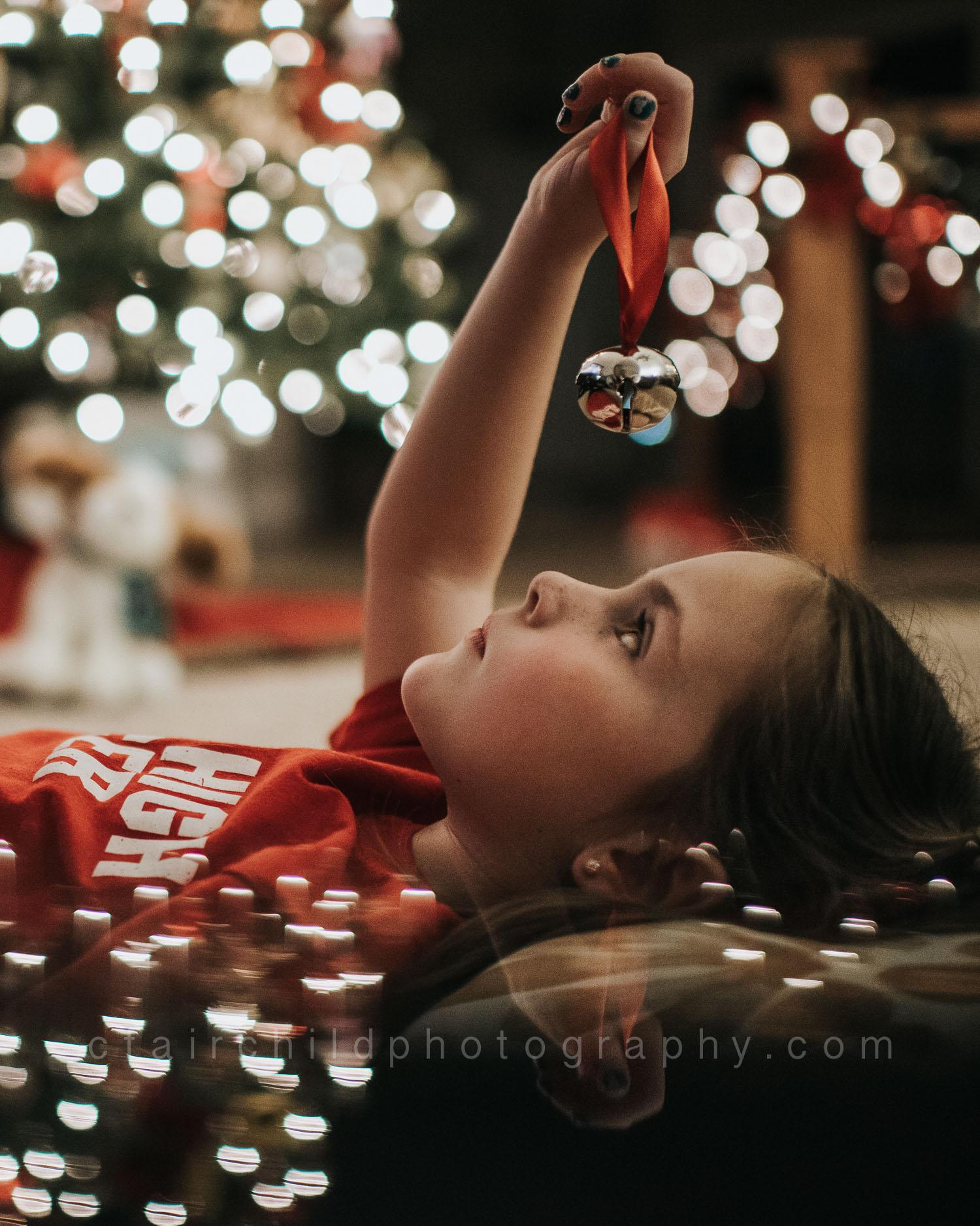 """My daughter, taken in December, while watching """"The Polar Express""""."""