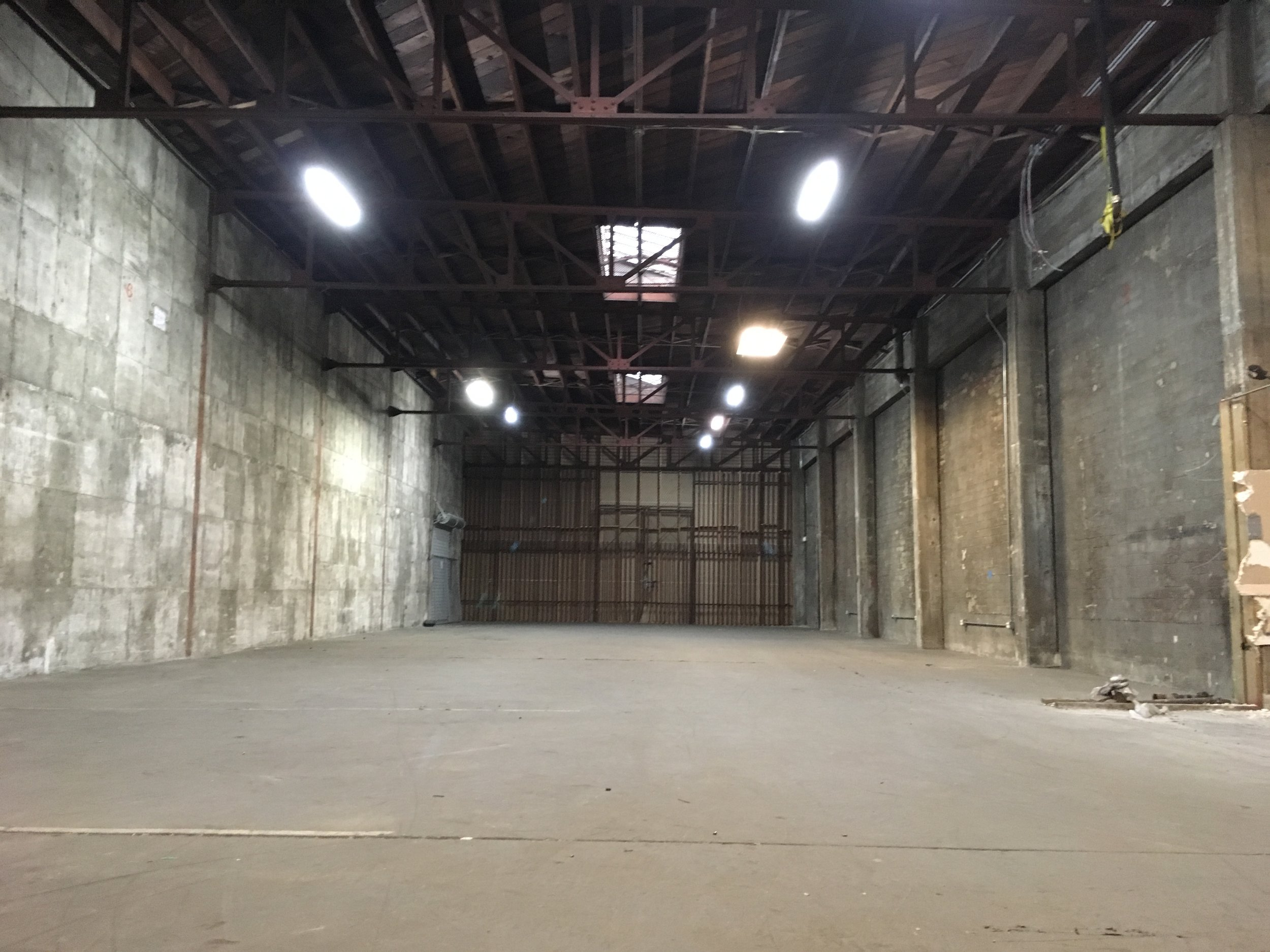 """""""BEFORE PHOTO"""" 4000 sq ft of raw concrete and the industrial elements. Can't wait till we can add a few of our toys to the mix."""