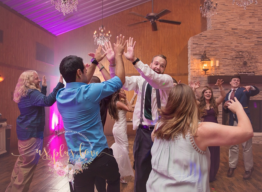 reception-dancing-wedding-fun-high-five-ashelynn-manor-exit-dance-photographer-documentary-rustic-wedding-family-together-77381-77002-77380-77382-77354-77384-77385-77375-77389-houston-area-fine-art.jpg