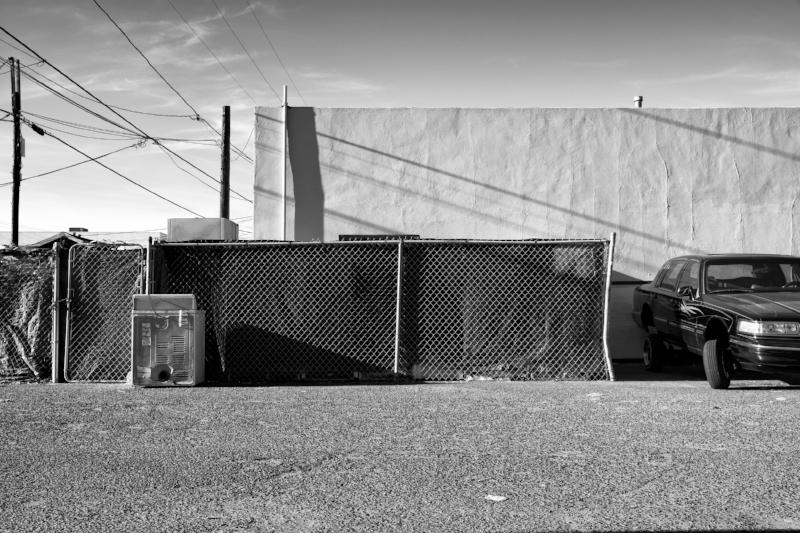 Lowrider And Discarded Appliance