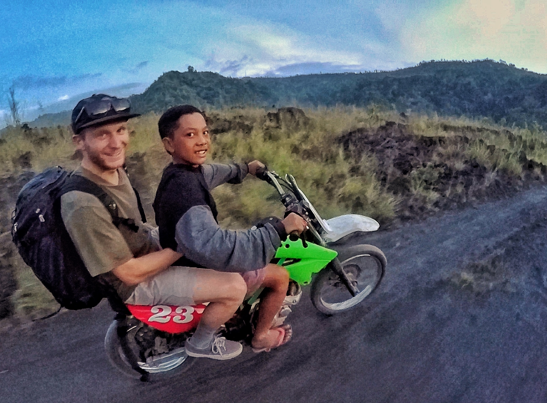 The hike out of the black sands was about 15 minutes on foot. Our camera guys had no transportation, so our curious friends insisted they hop onto the back of their motos.  The boy pictured here is 10 years old, and dreams of becoming a pro motocross racer.