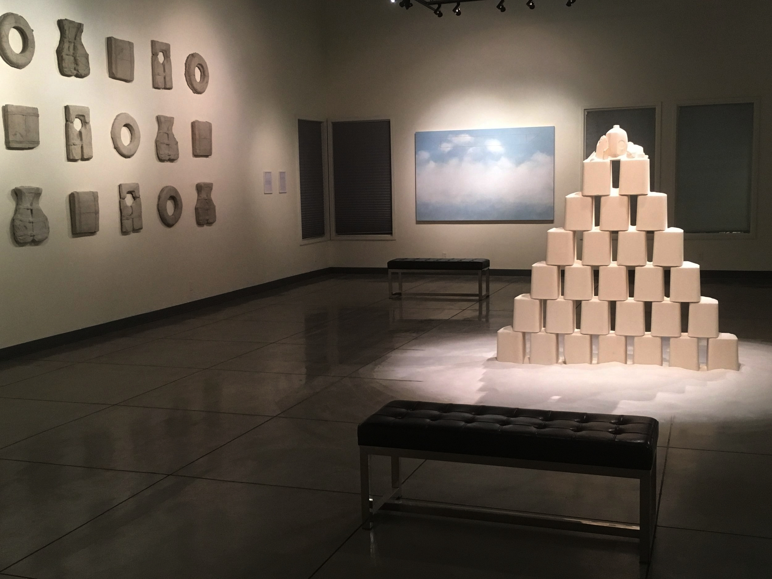 "Gallery install shot from left to right ""Current"" (cement), ""Untitled. Unknown."" (acrylic on canvas), and ""Salvation"" (1200+pounds of salt)."