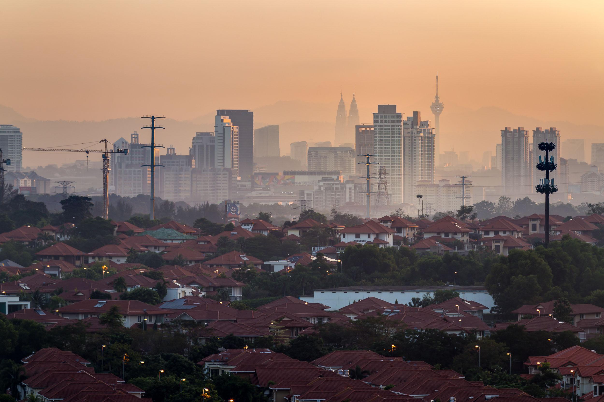 malaysia kuala lumpur sunrise haze inner city orange cityscape travel.jpg