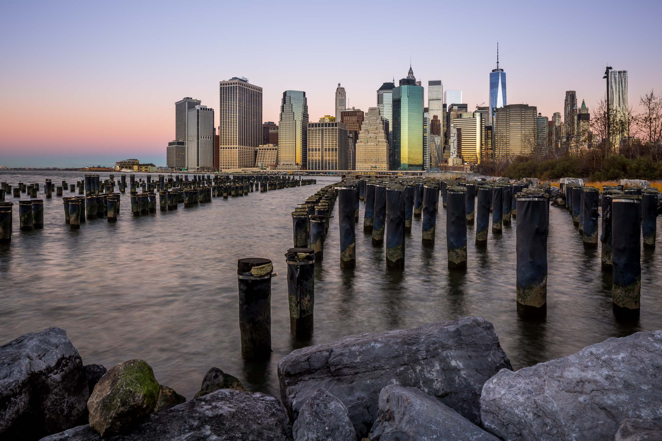 nyc manhattan island downtown hudson river brooklyn bridge park wall street sunrise.jpg
