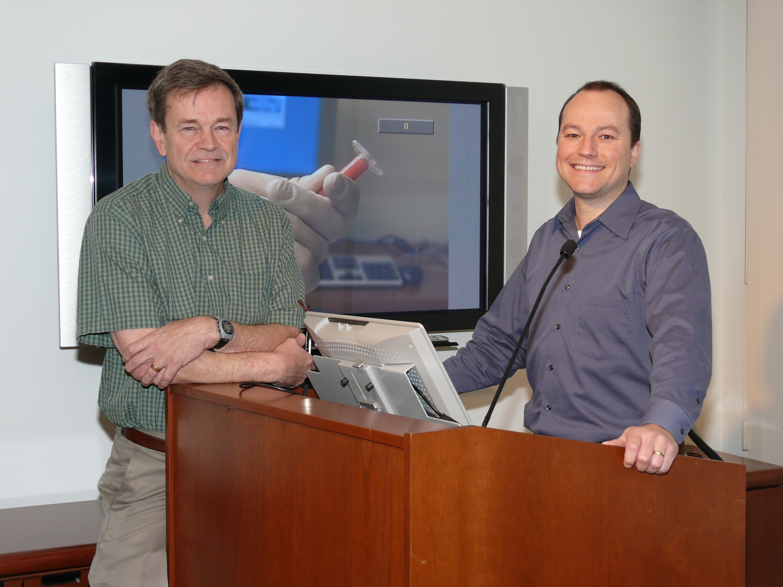 Drs. Jim Kobler and James Heaton prepare to give a lecture in the Voice Center Conference Room.