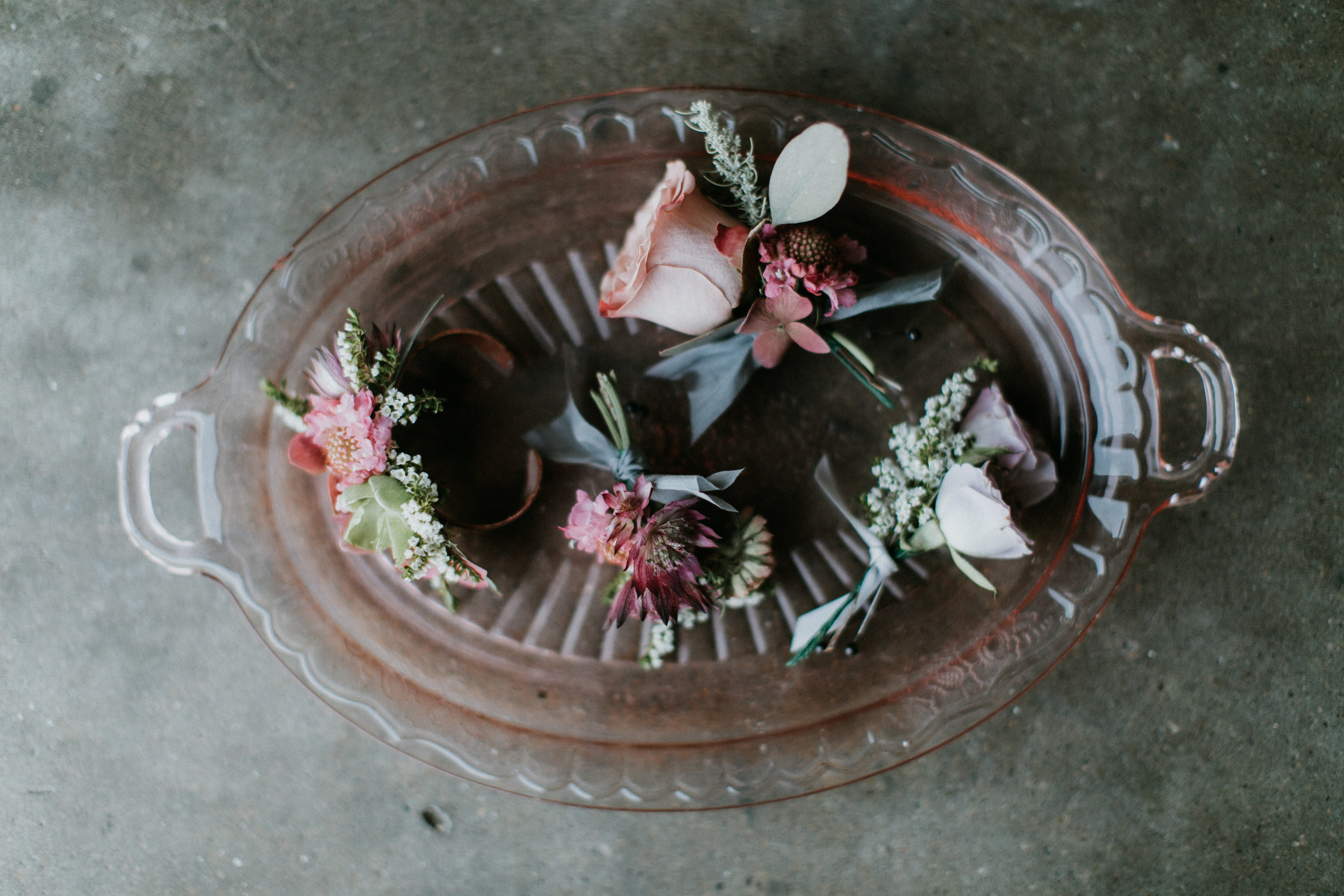 Boutonniere's styled on glass tray