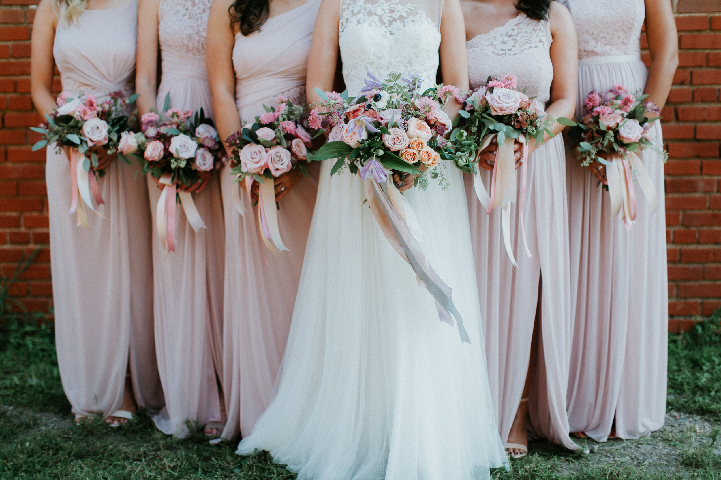 Bride & Bridesmaids with lush garden style bouquets in shades of mauve, peach and lavendar