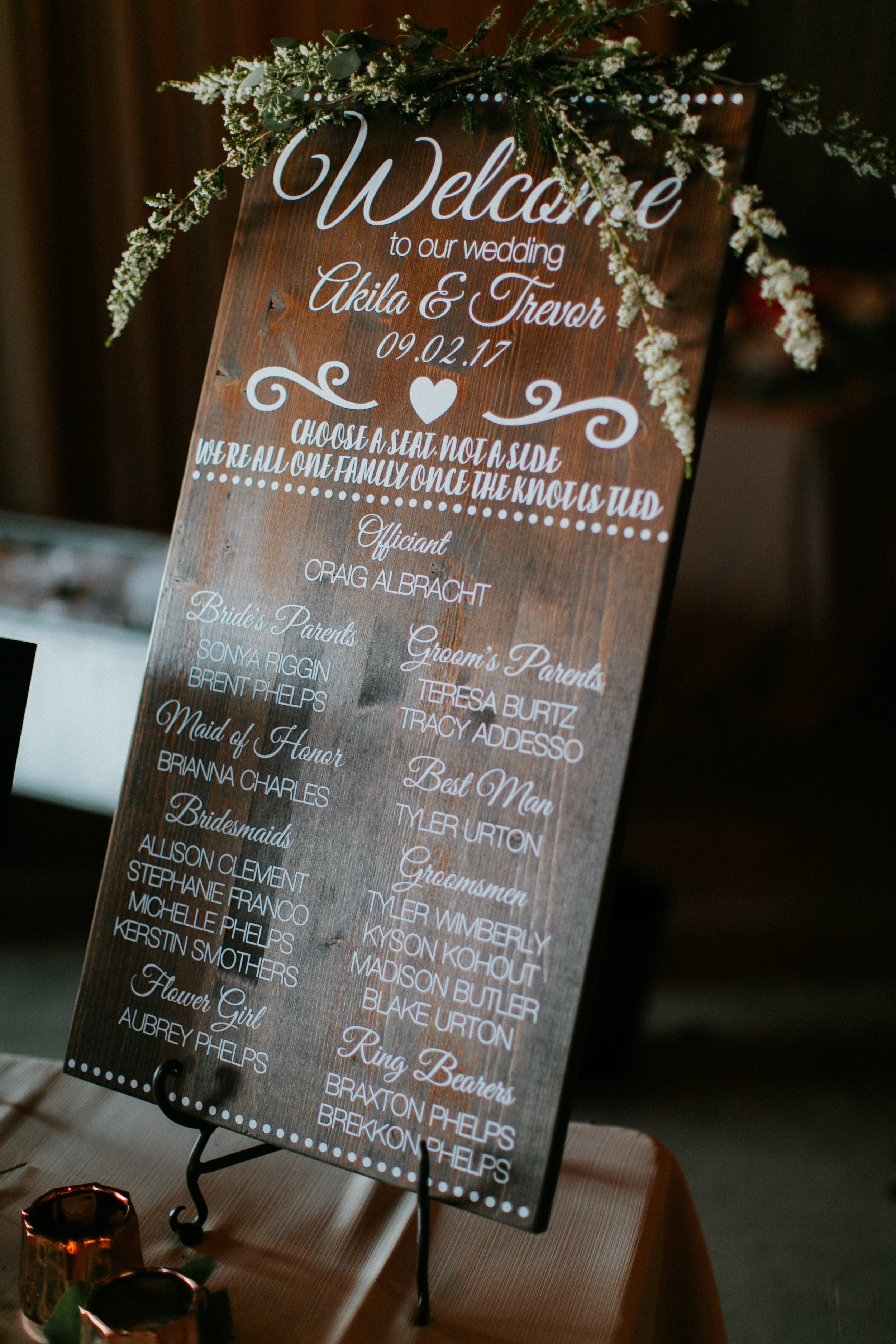 Greenery and floral garland on wedding sign