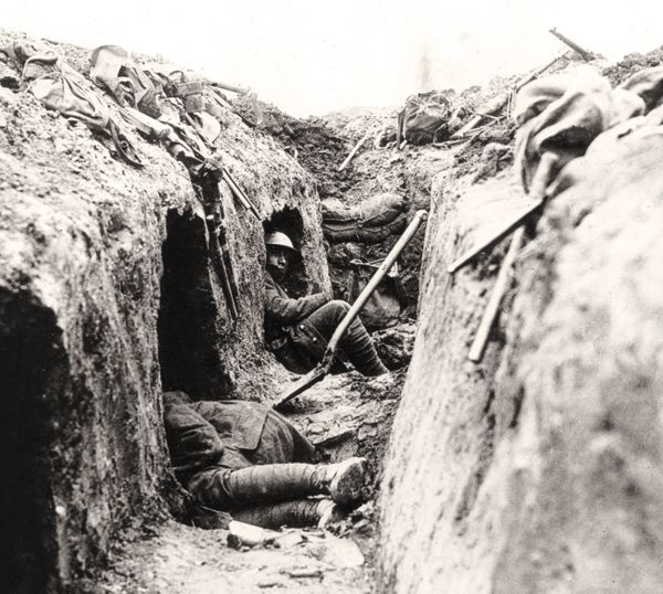 Note the 'funk-holes' dug into the front wall of the trench as a refuge from shell fire.