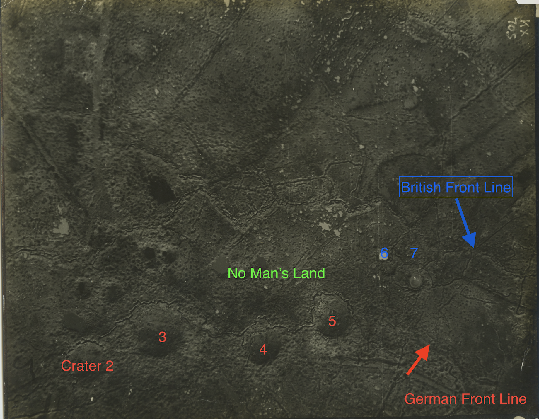 An aerial photograph of roughly the same area shown in the preceding maps. The four large craters across the bottom correspond to numbers 2-5 on the preceding maps. Nicholls' Company occupied Craters 6 and 7 (blue) just northeast of 5. Note how many more craters there are in reality than in the maps.