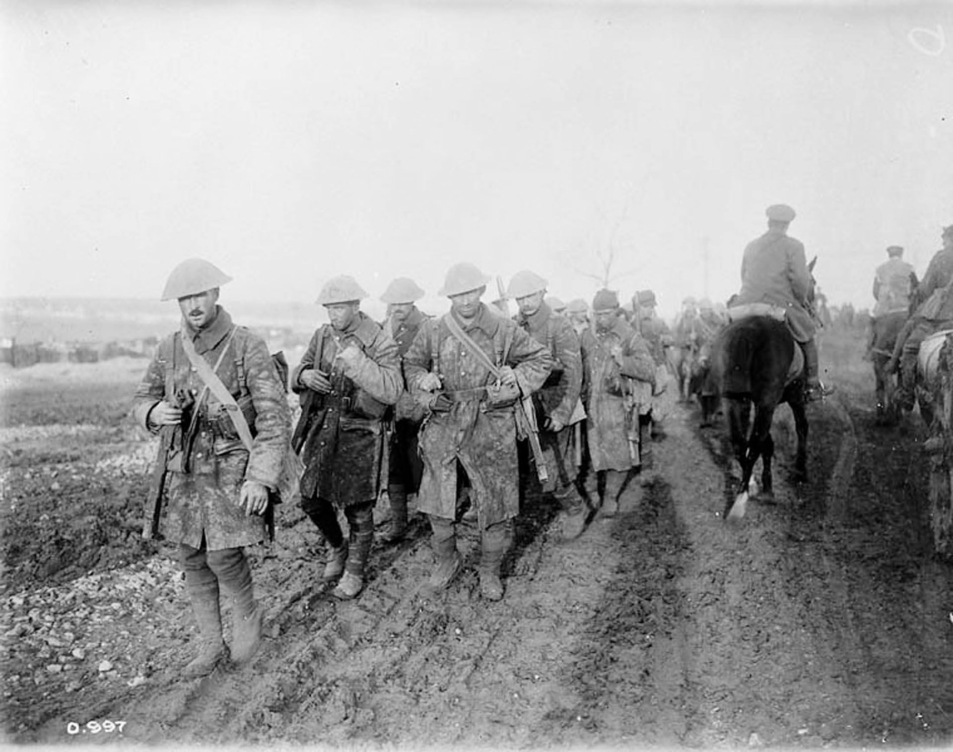 Canadians marching on the Somme. This dates from the autumn following Nicholls' injury but still gives a good impression of marching conditions during his service.