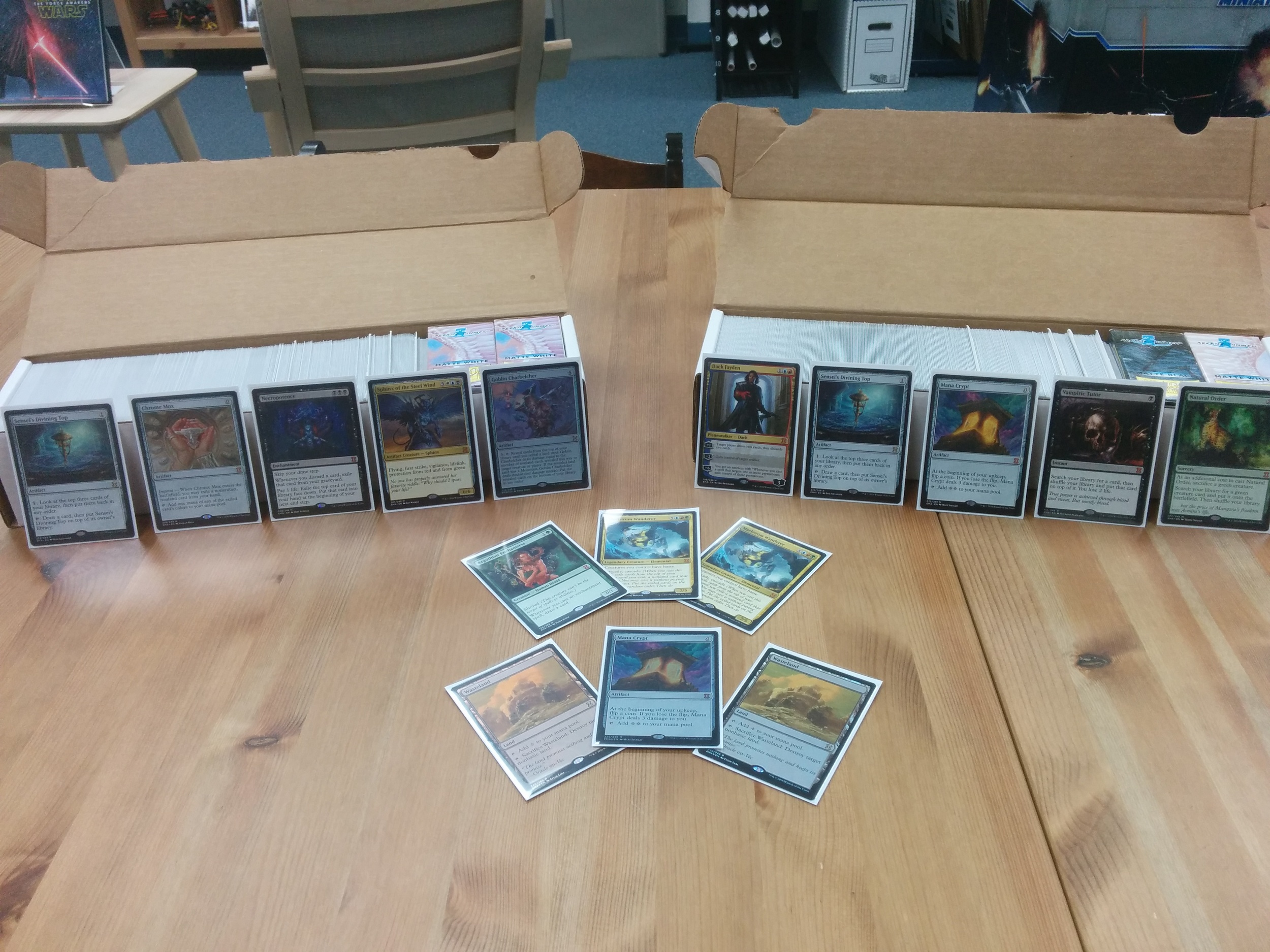 Yes, that's a foil Mana Crypt flanked by two foil Wastelands up front.