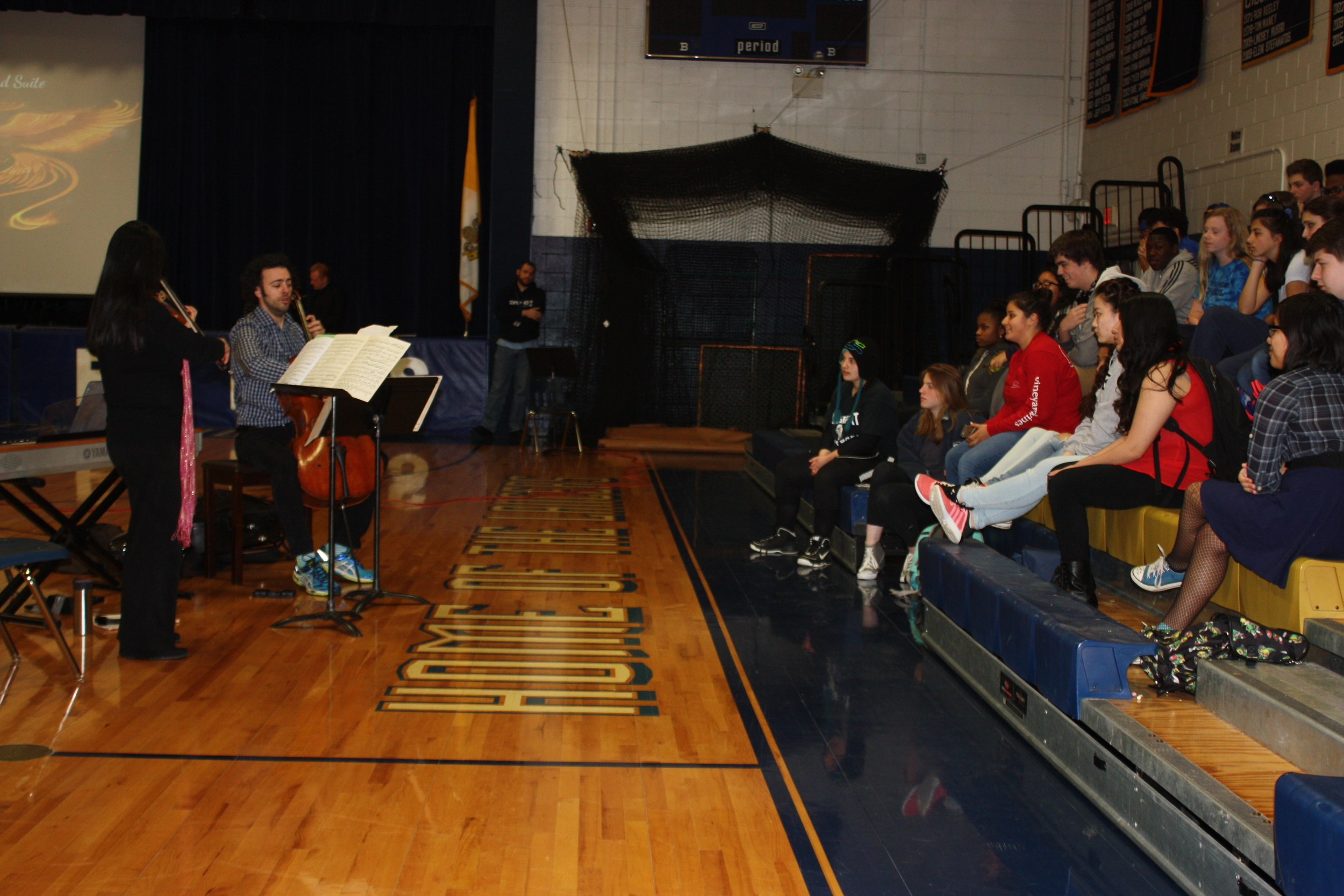 Deborah Wong and Eric Jacobsen perform for the music, drama and chorale students at Notre Dame High School in Fairfield, April 8.