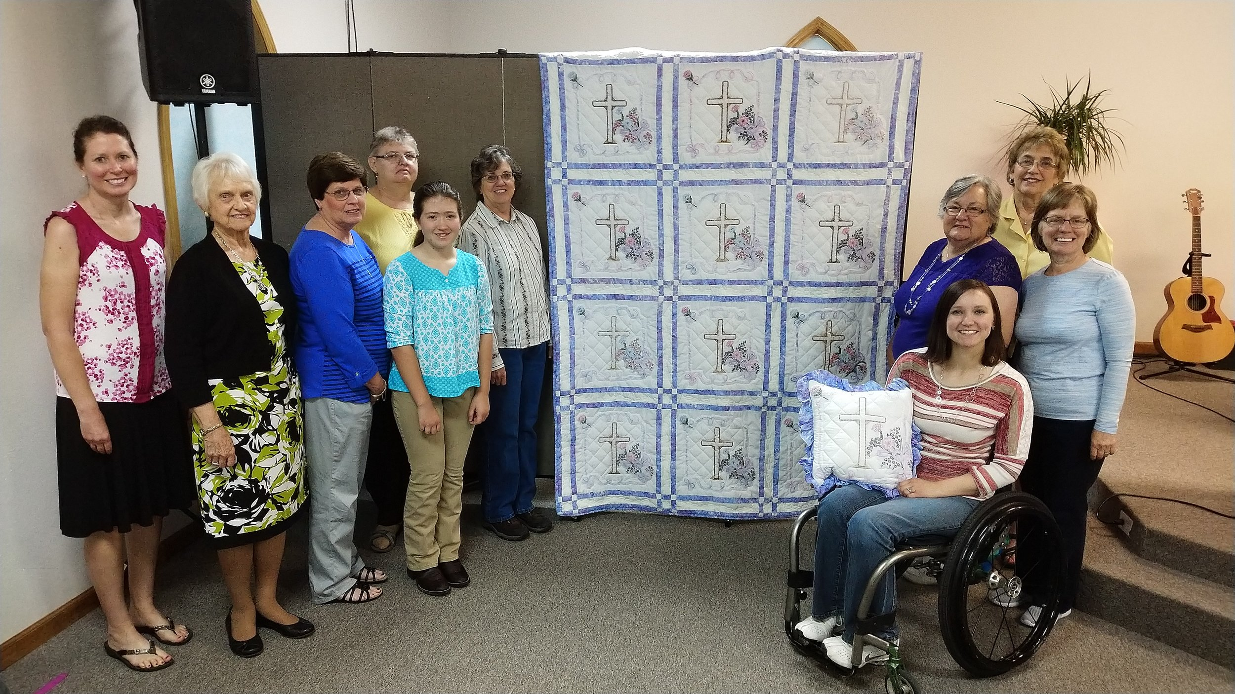 The dedicated ladies who helped with the Strawberry Festival quilt.  From left to right: Amy Brown, Bonnie Stone, Ruth David, Debbie Wheeler, Faith Brown, Carolyn Maupin, Becky Blackwell, Judy Colbert, Cathy Mitchell, and RhoAnn Hanes.