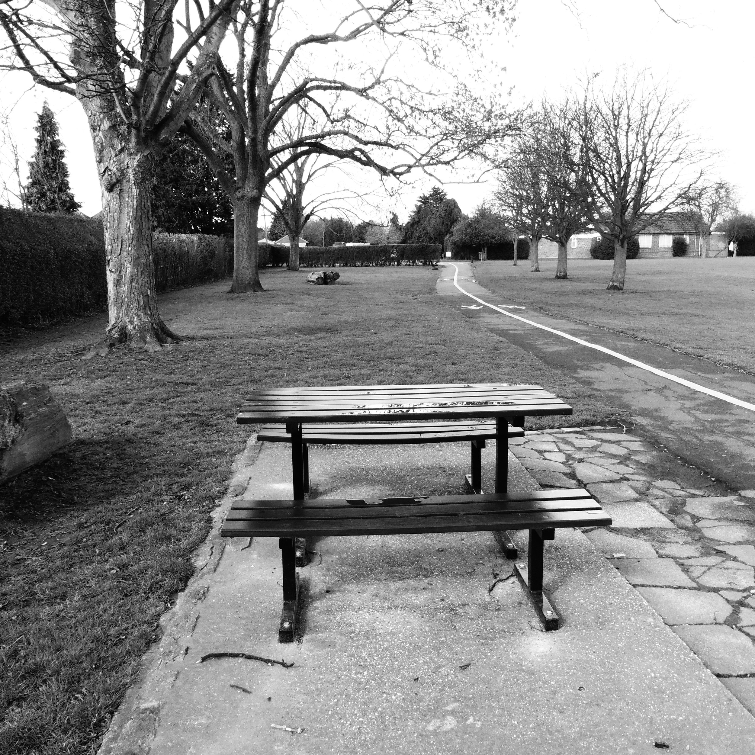 Empty bench and table, by Terry Freedman