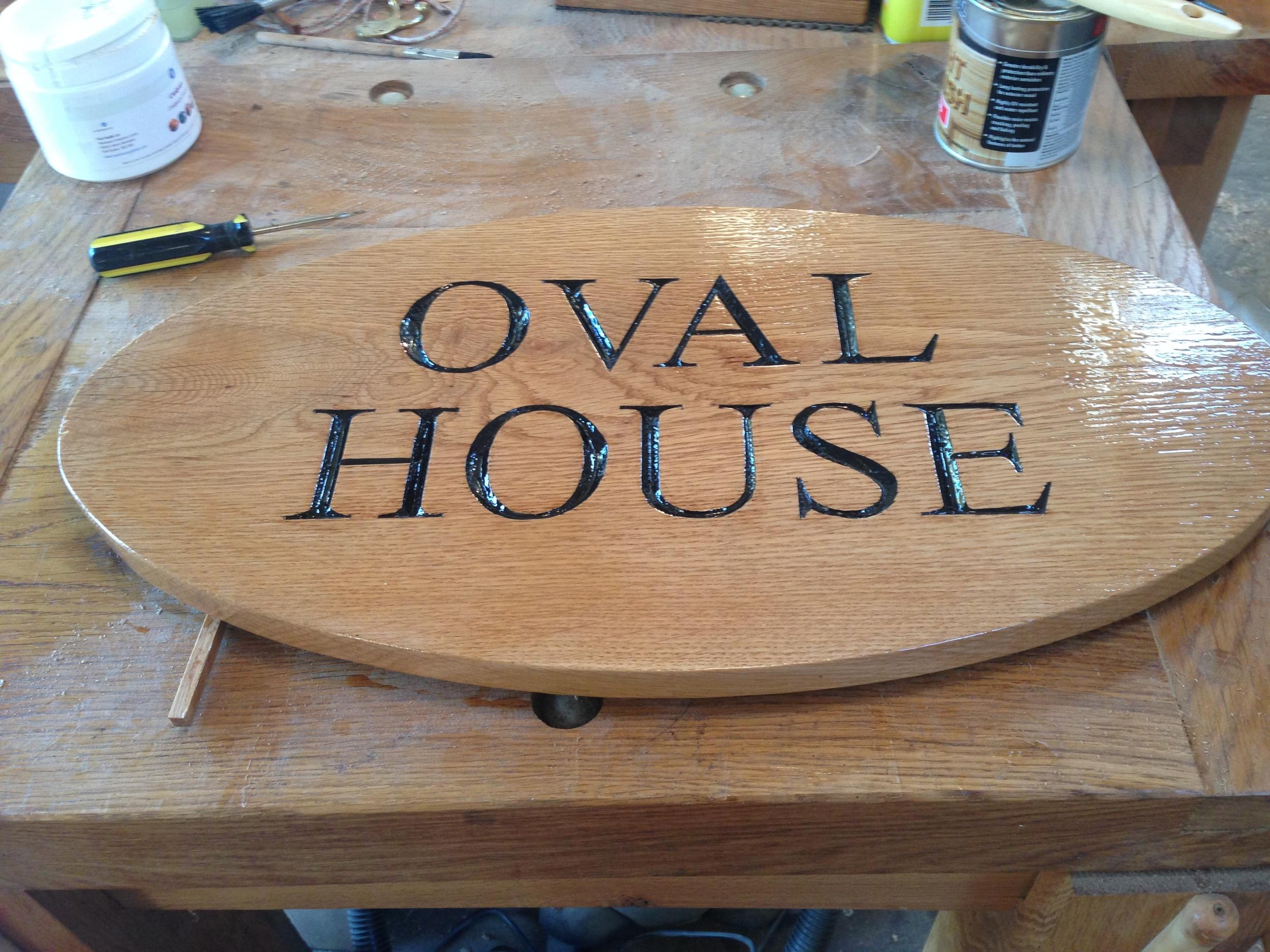 """An """"Oval"""" sign in oak"""
