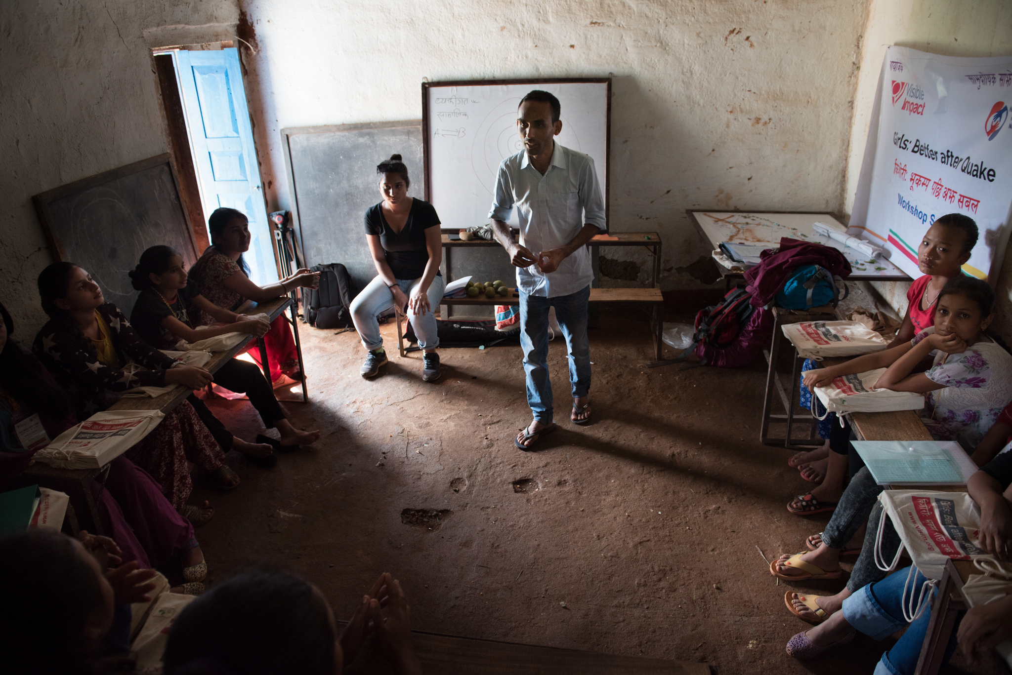 Accountability Lab's Suresh Chand and Samita Thapa talk to 15 girls at a school house in Nuwakot, Nepal about accountability and integrity. (Photo by Brittany Wait)
