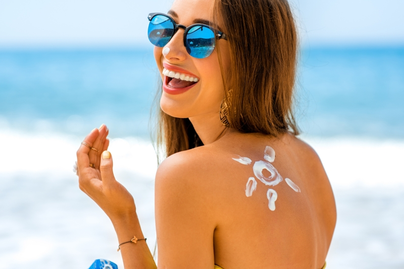 summer skin tips with woman on beach in san diego