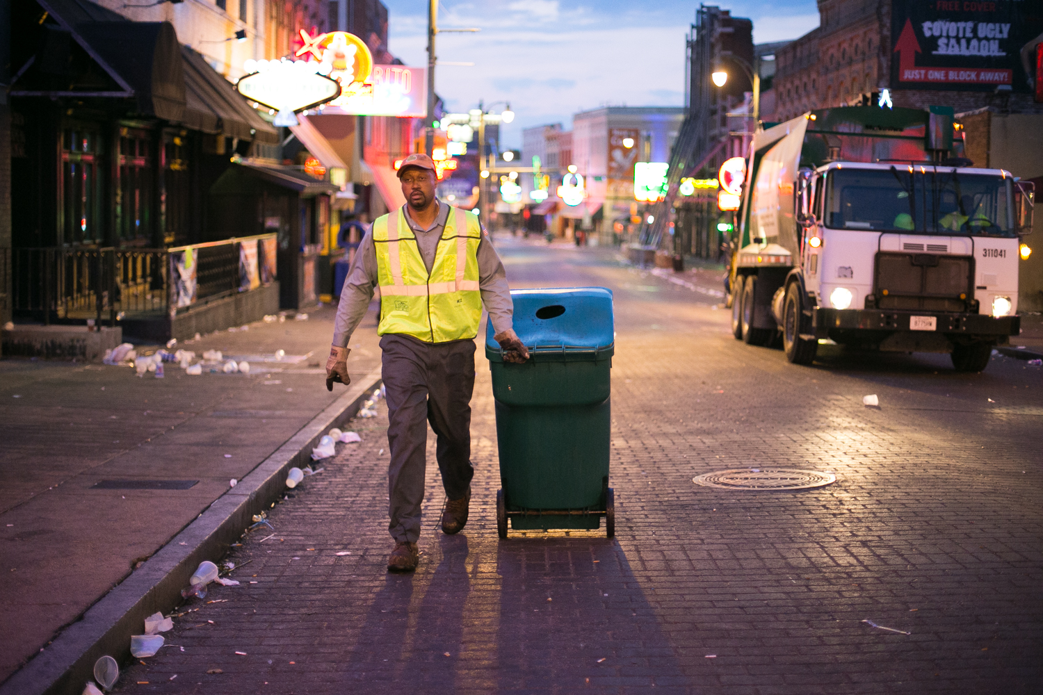 While most people are asleep in their beds, six-seven big Kevin is just finishing his clean sweep on Beale Street. He and his co-worker empty every last trash can that lines the Memphis party strip.