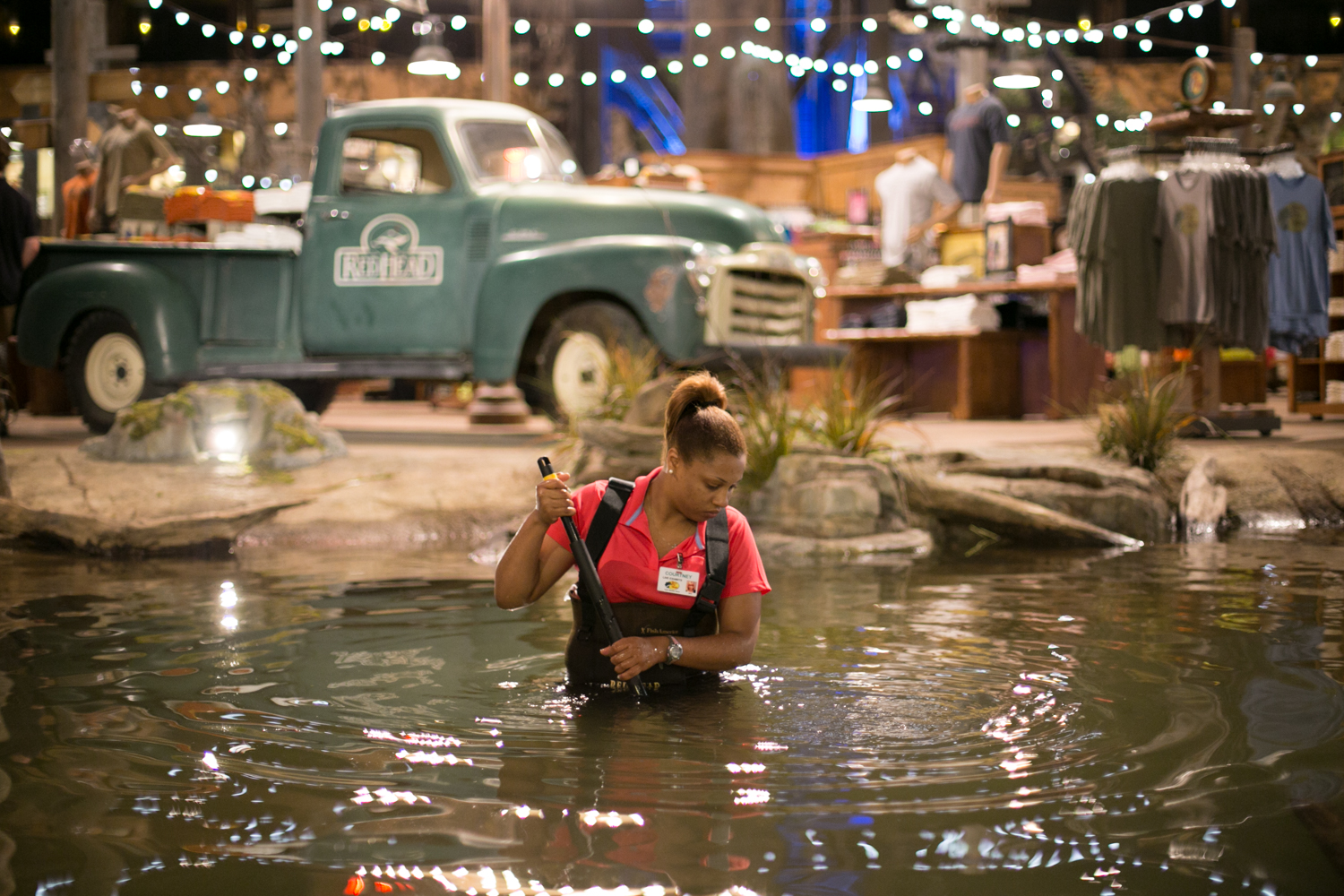 Courtney gives the rainbow trout pond a scrubbing at the new Bass Pro Shop in Memphis. Next up could be the 84,000-gallon alligator habitat.