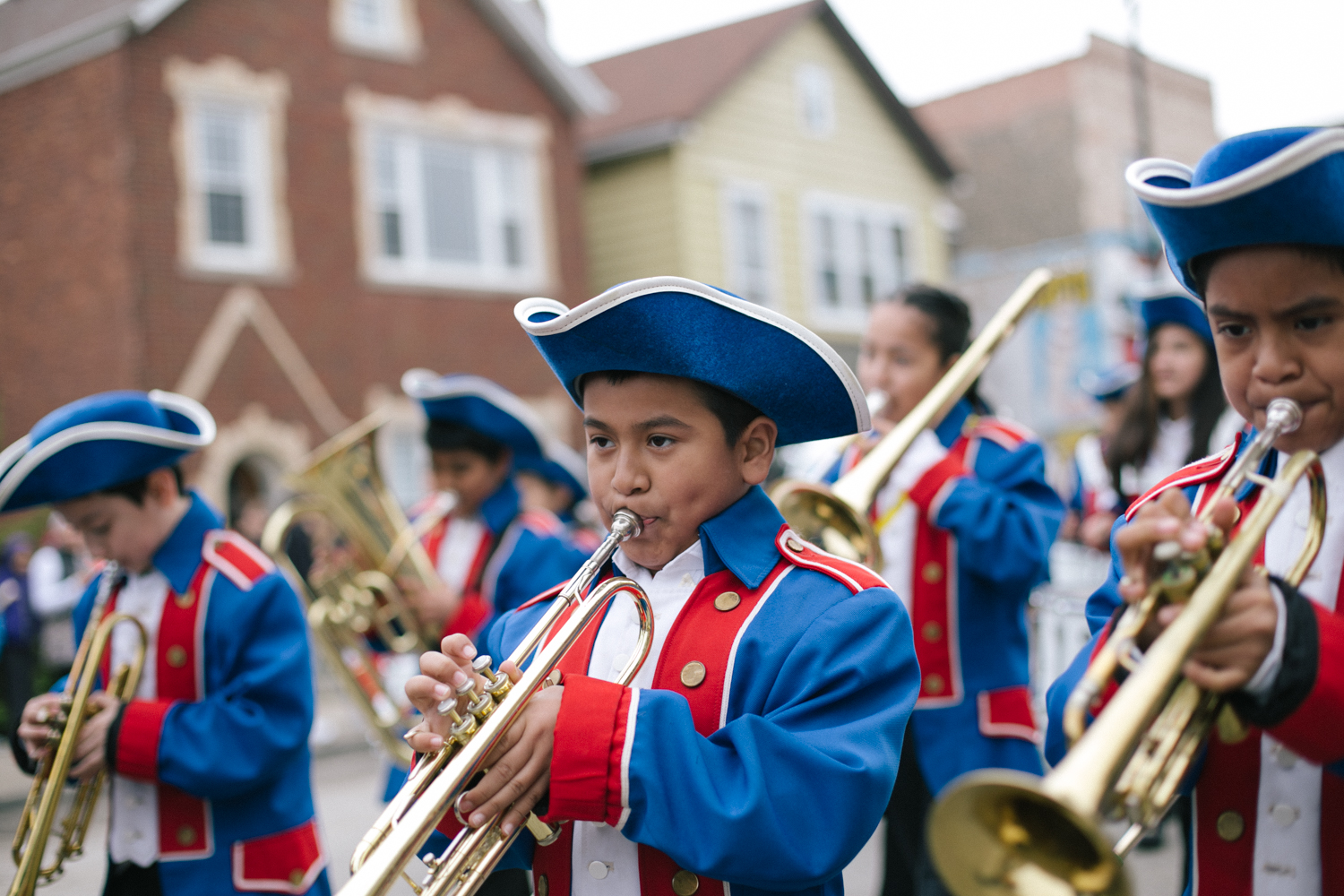 One of the niños from the Tonti Elementary School Marching Band toots his horn during the Cinco de Mayo parade in the Little Village neighborhood. 4/24
