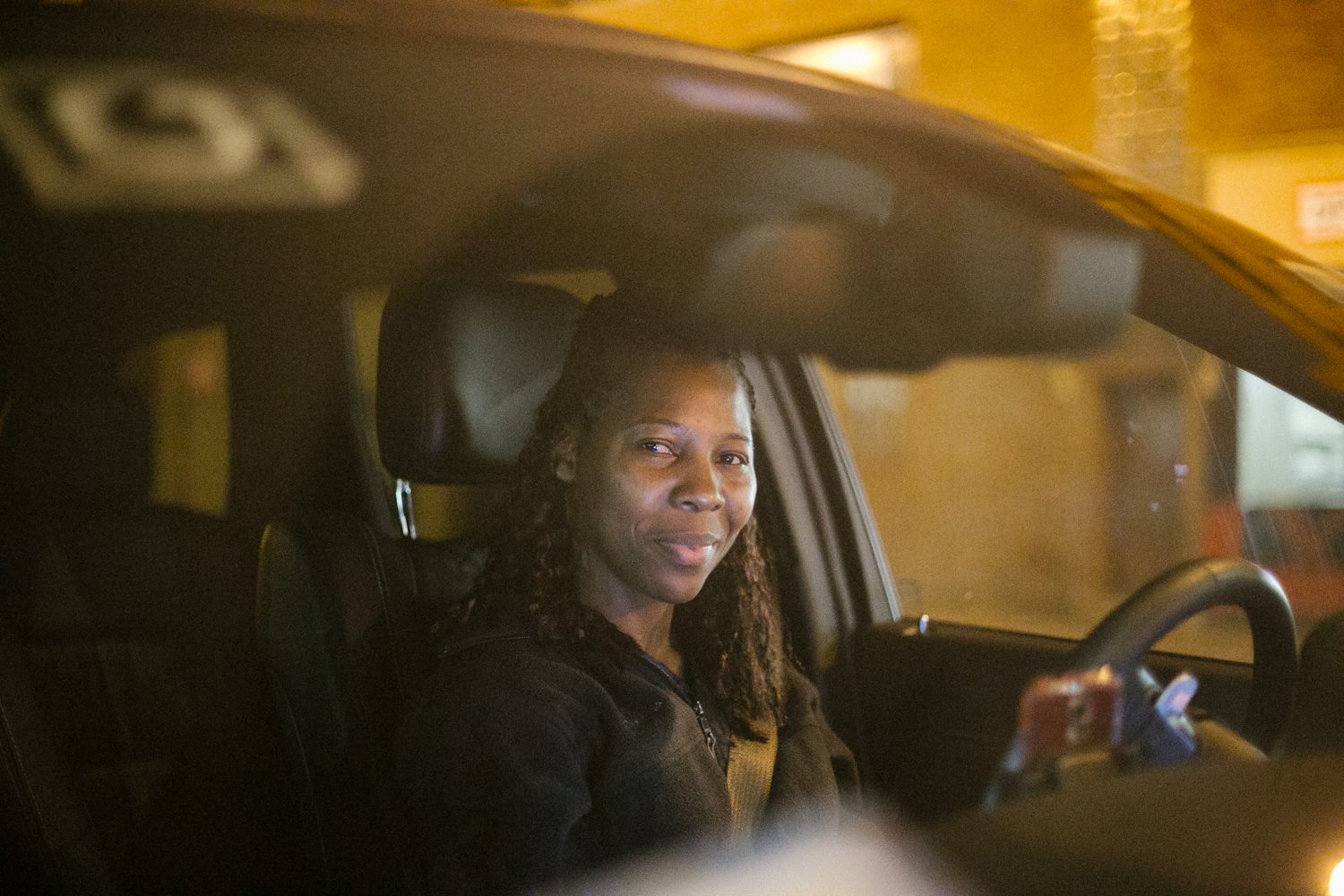 Efia, who was born in the Caribbean, raised in New York, has been driving for Uber for a year and a half. 30 rides given yesterday. 16/24