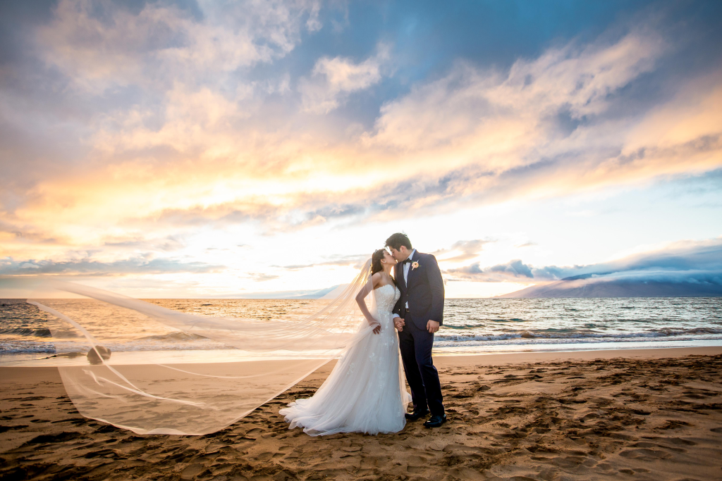 Perfect wedding background: golden sand beach at sunset