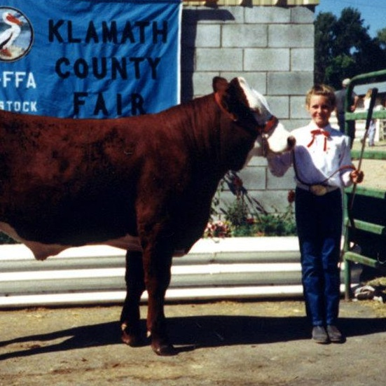 Hey! Summer vacation. Let's do some really hard work all summer, like raising and training livestock! My 4-H steer and I, c. 1991.