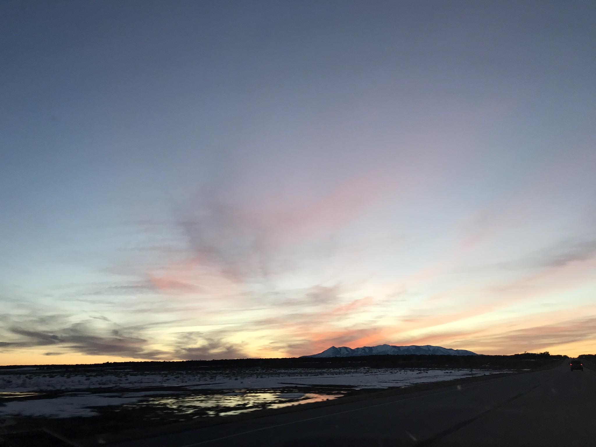 The sun setting somewhere around the Colorado & Utah border