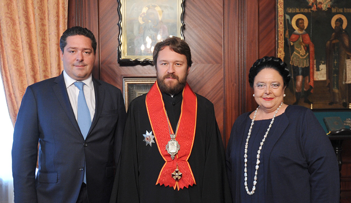 Grand Duchess Maria Vladimirovna and Grand Duke George with Metropolitan Hilarion (Alfeyev) of Volokolams, the chairman of the Department of External Church Relations, permanent member of the Holy Synod of the Russian Orthodox Church, and a Knight of the Order of Saint Anna, 1st Class, awarded in 2013.