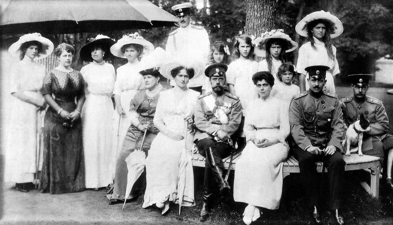 "Grand Duchess Maria's branch of the family, the ""Vladimirovichi"" with Emperor Nicholas iI and Empress Alexandra in 1913.  From left to right:  Grand Duchess Tatiana   Nikolaevna; Duchess Marie of Mecklenburg-Strelitz; Grand Duchess Victoria Feodorvna; Grand Duchess Olga Nikolaevna; Grand Duchess Vladimir; Empress Alexandra; (standing behind, Grand   Duke Kirill); Nicholas II; Princess Nicholas of Greece the daughter of Grand Duchess Vladimir; (standing behind, the three little girls are:)   Princess Nicholas' daughters, Princesses Elizabeth, Olga, and Marina (the future Duchess of Kent) of Greece; the other two girls are Grand Duchesses   Anastasia and Maria Nikolaevna; and in frontal right, are Grand Duke Kirill's brothers, the Grand Dukes Boris and Andrei."