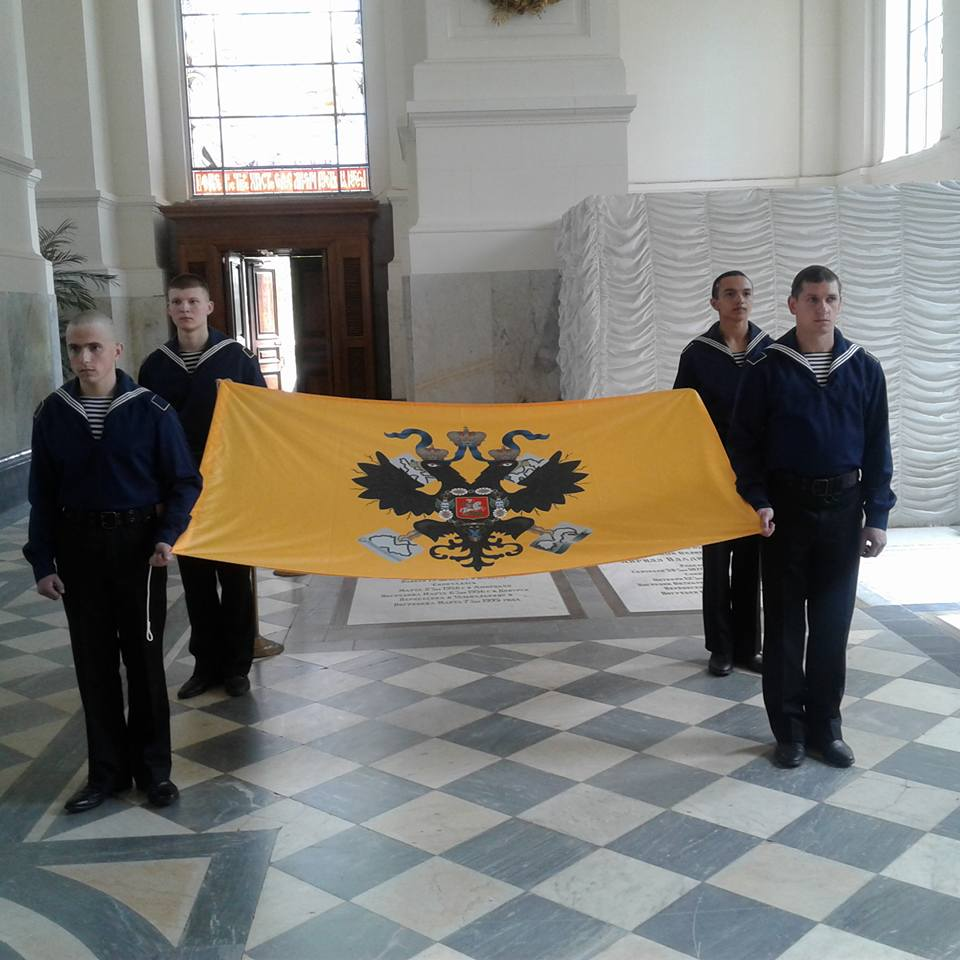 The St. Petersburg Naval Cadets hold the flag of the Russian Imperial Navy in the Grand Ducal Mausoleum of the Cathedral of St. Peter and Paul in St. Petersburg.