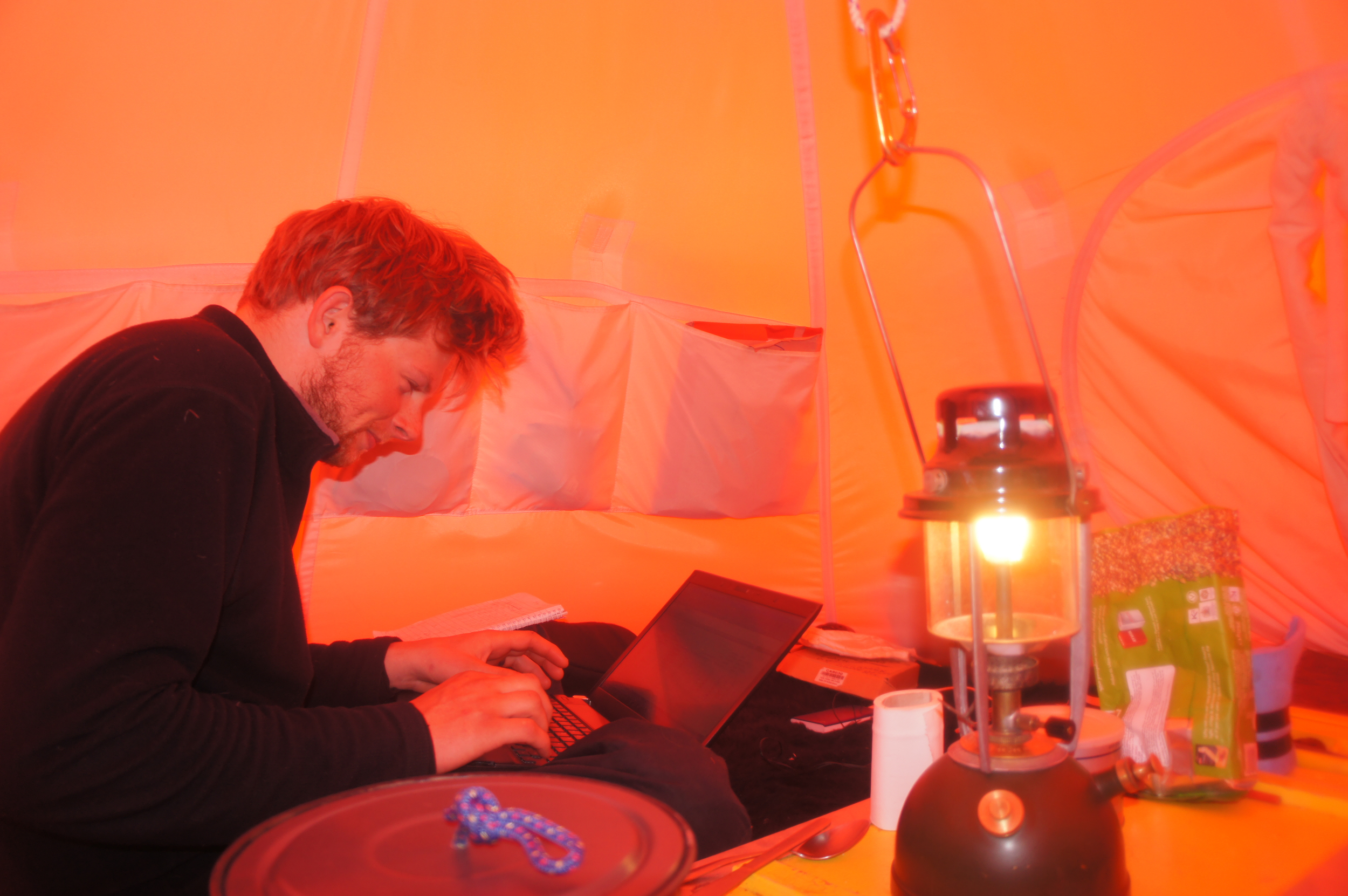 Dr. Kingslake hard at work in the tent