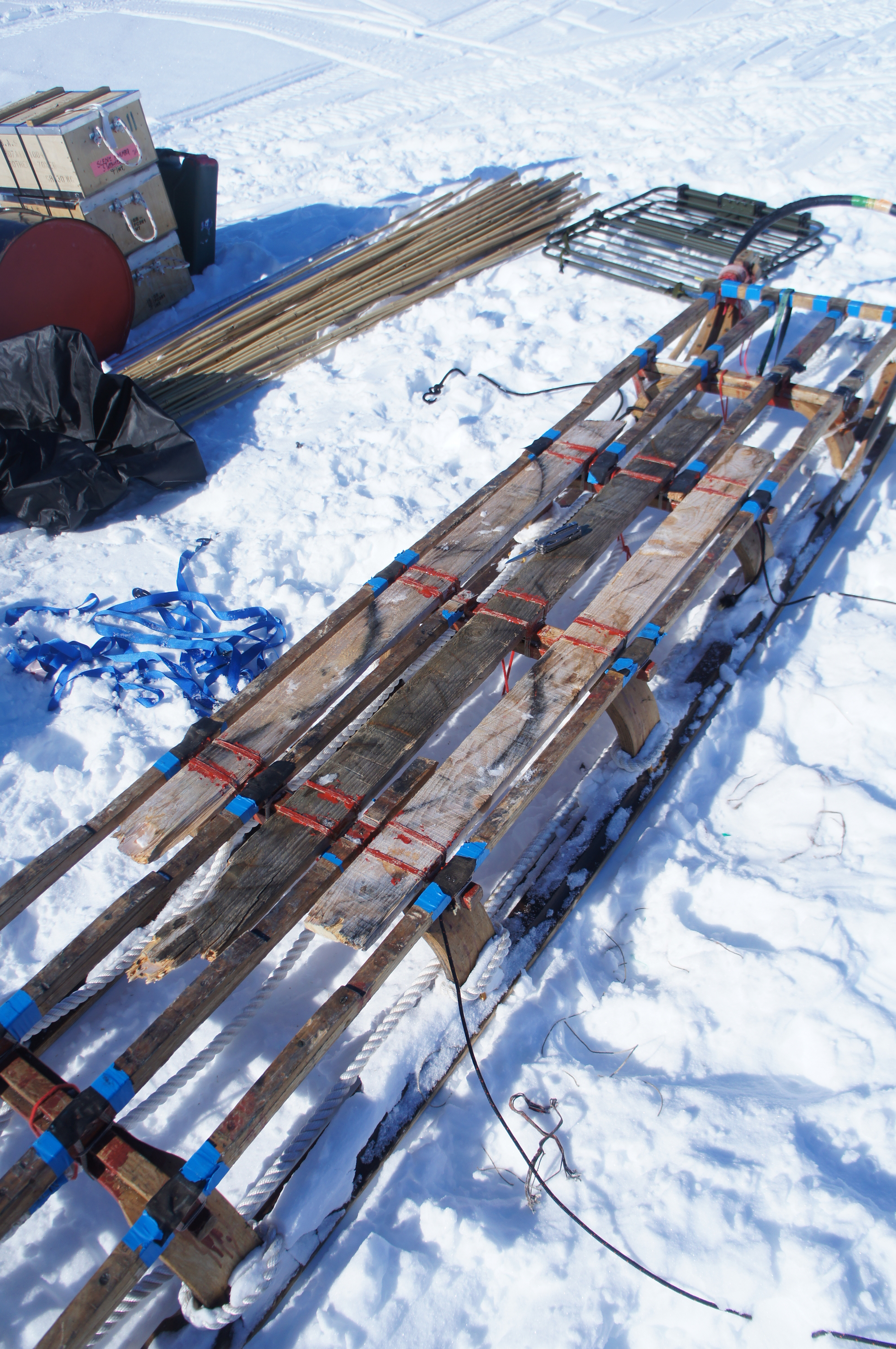 Field repair of Nansen sledge, battered on hard wind blown surfaces