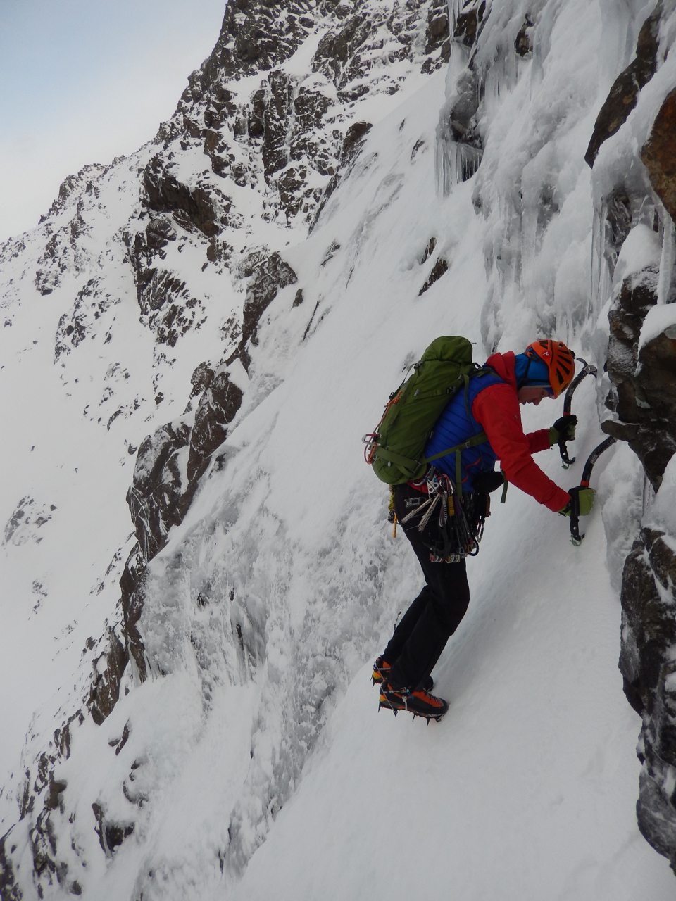Joris hunting for an anchor at the start of pitch 2