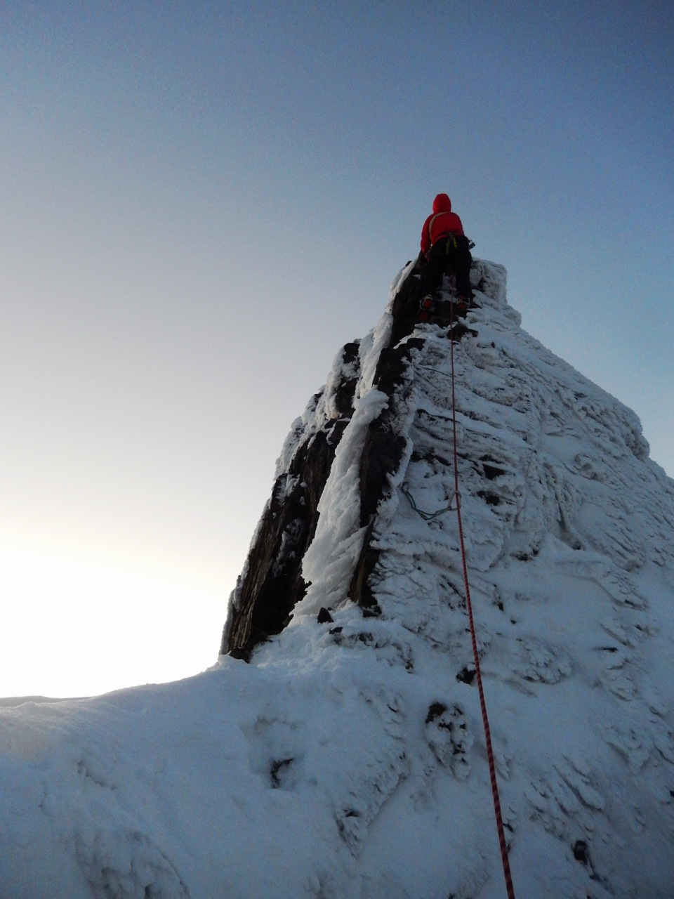 Joris charging up the crux of the Inn Pinn