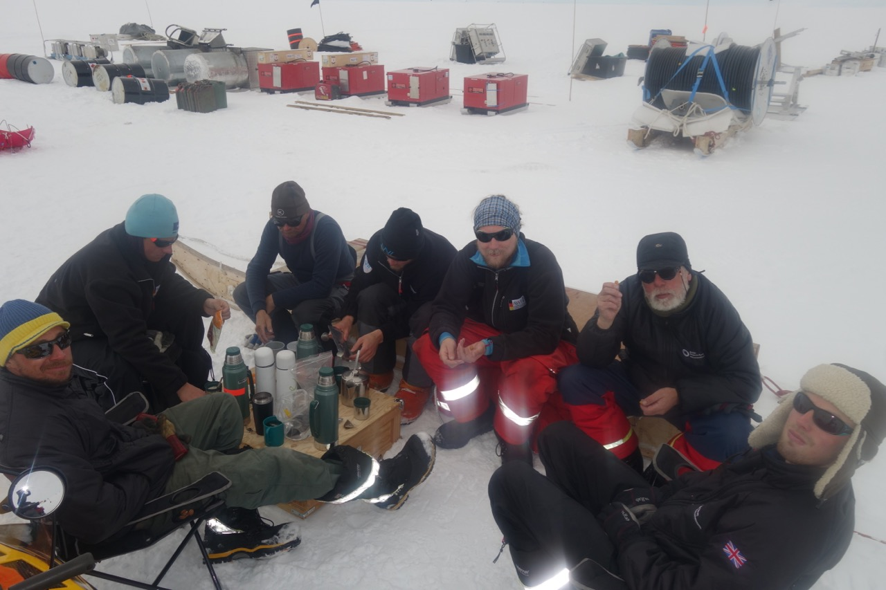 The team enjoying a coffee break after moving camp