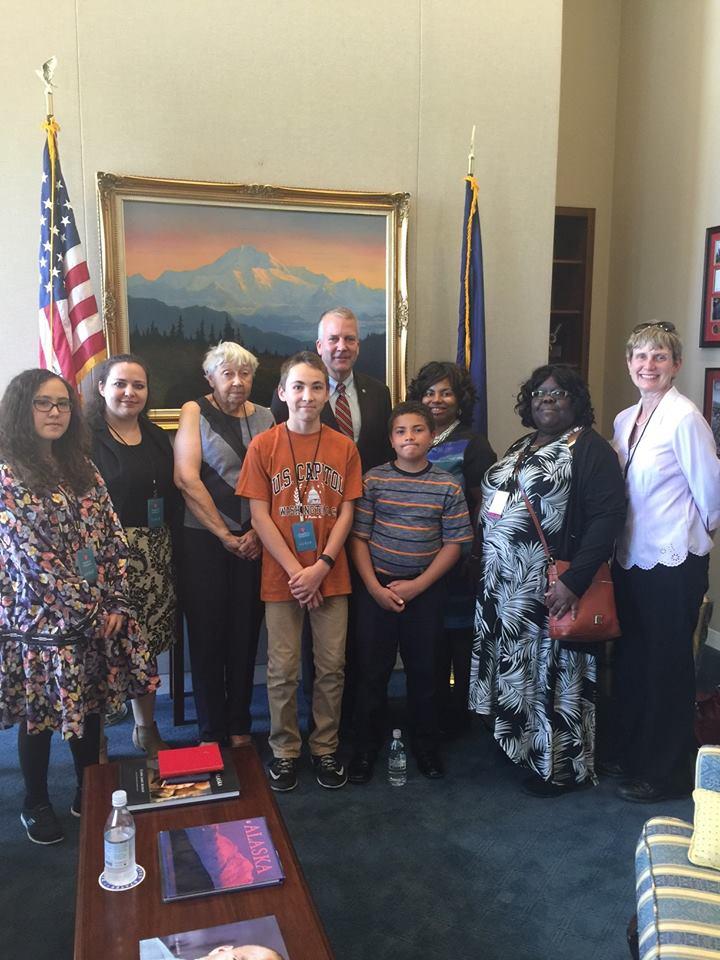 Rozann Kimpton with her family & Senator Sullivan.