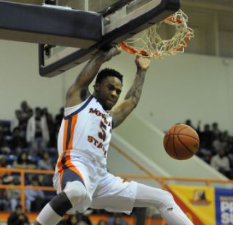 Kendley angrily dunks to prove to me he should have been the MEAC cover photo, not a guy who hooped in 2002