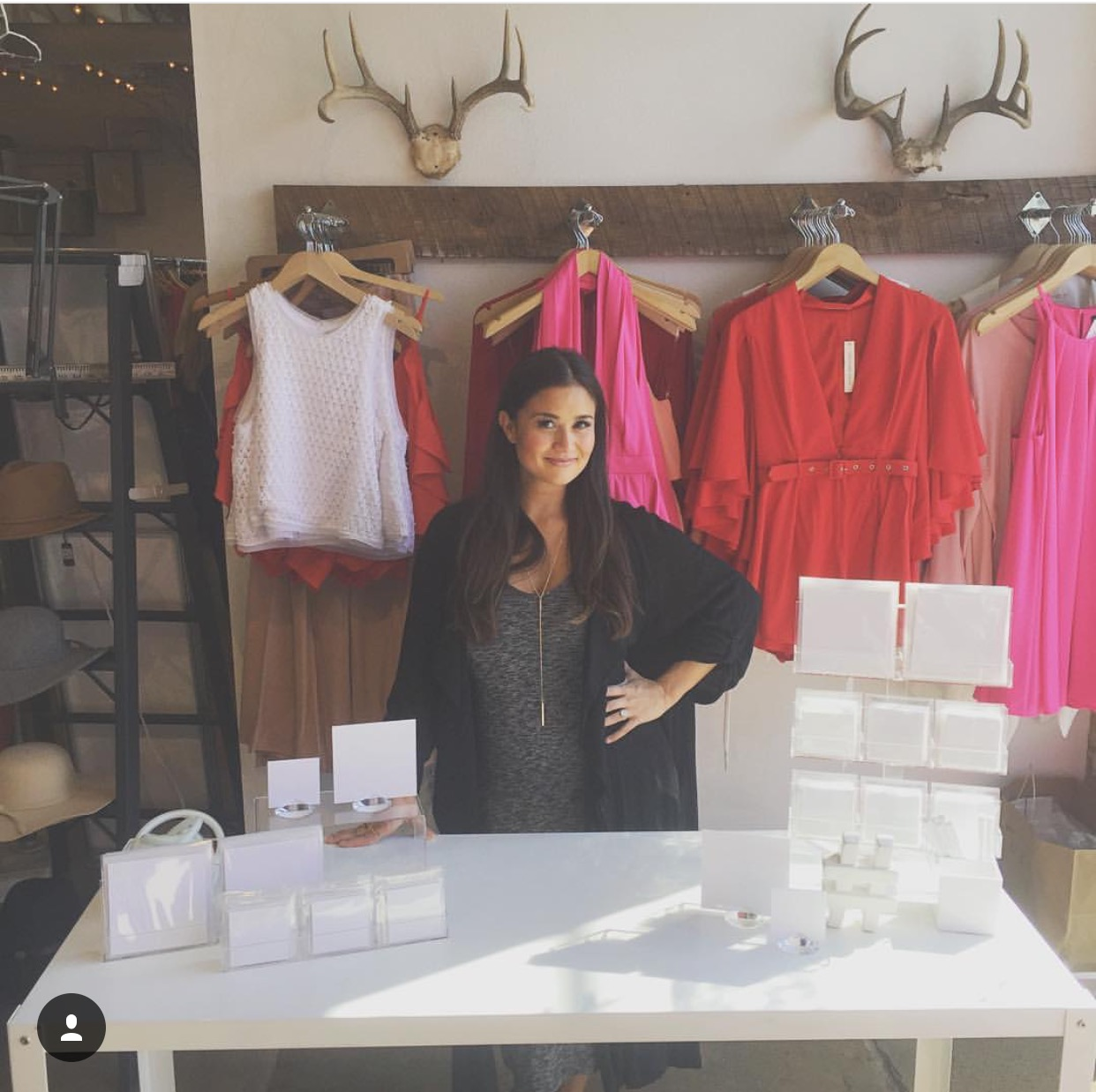 Catherine Lowe with her LoweCo. card display at Milk & Honey Boutique for a Valentine's Day event.