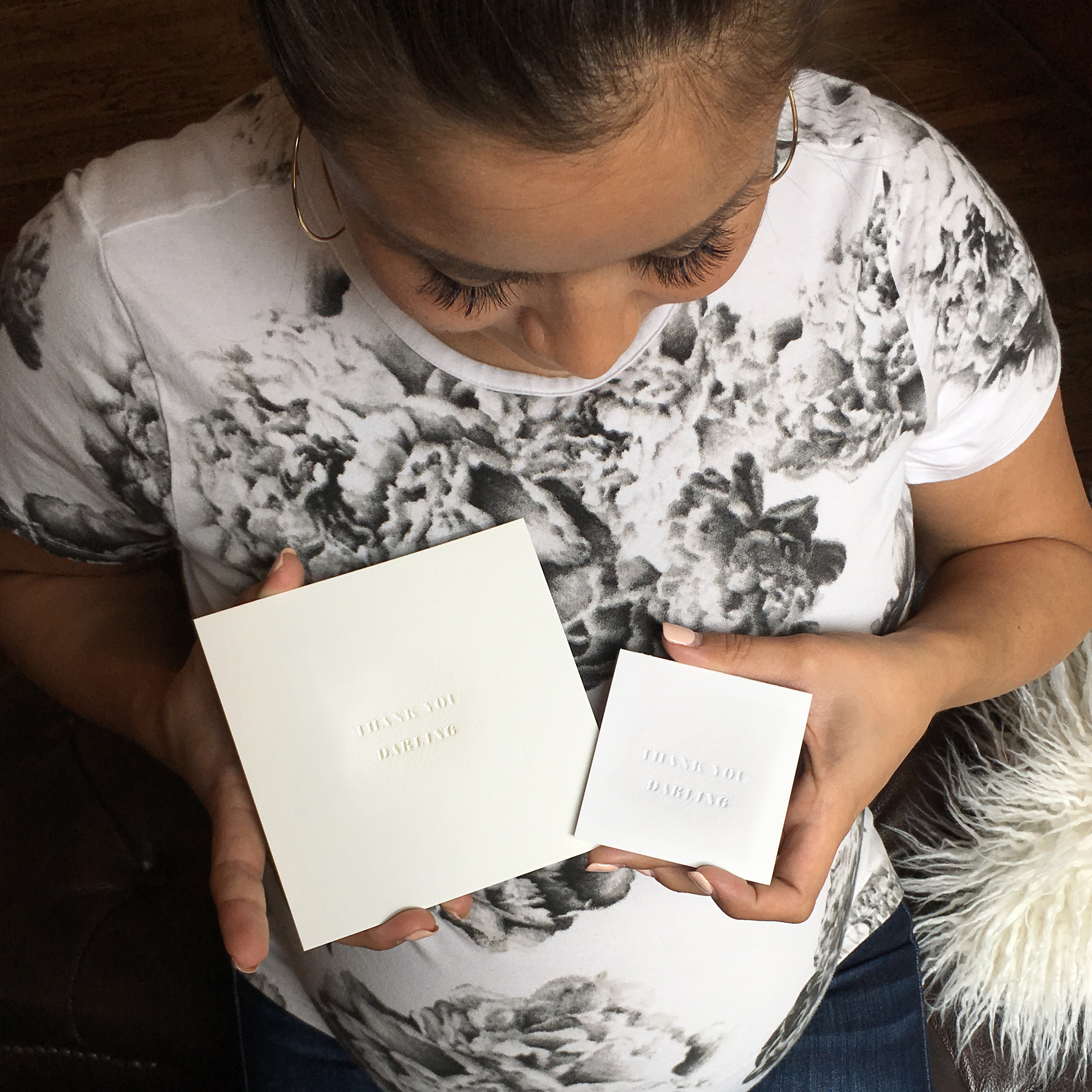 Catherine Lowe holding both sizes of our THANK YOU DARLING cards.