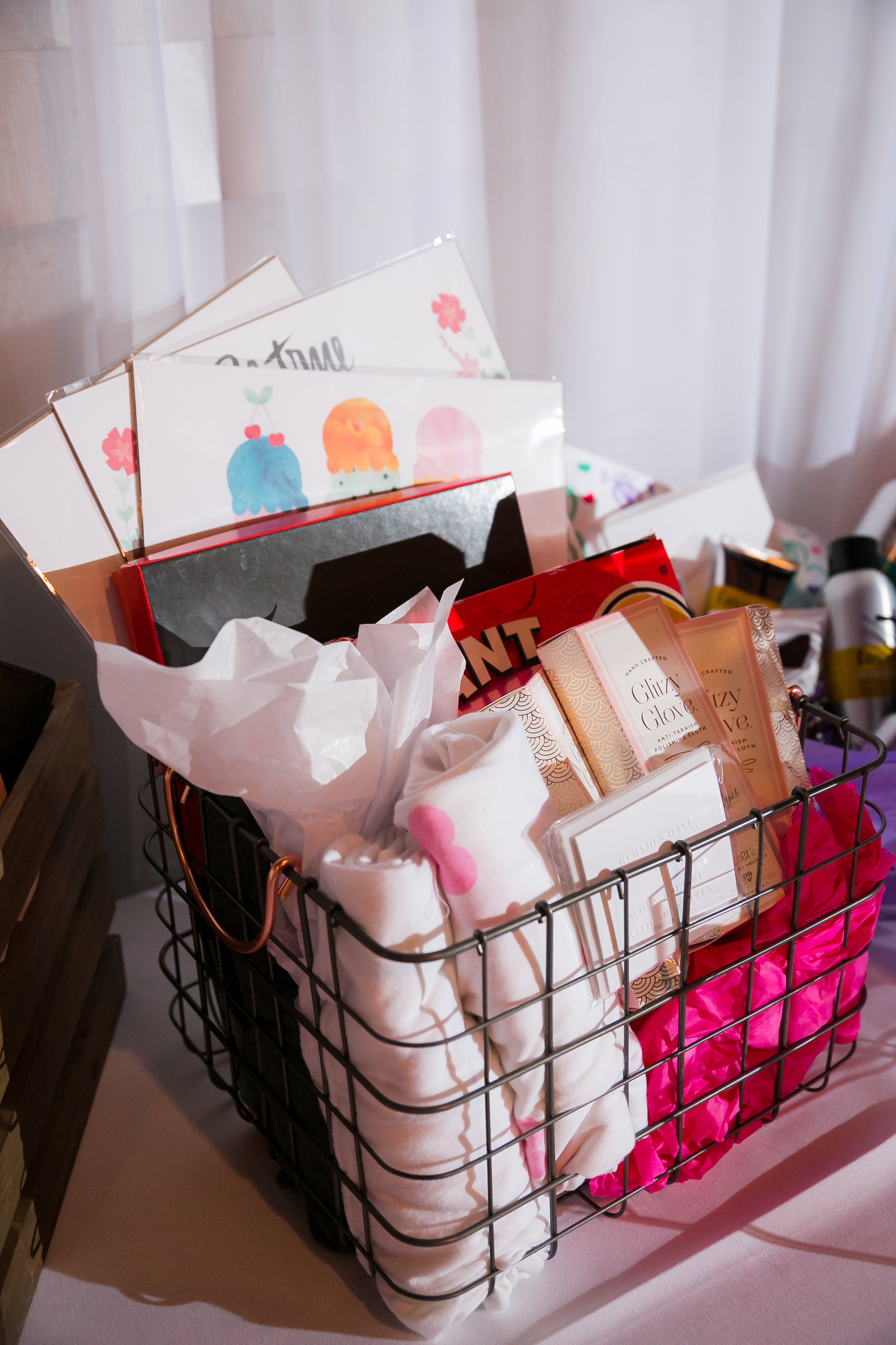 """Seven baskets in total were raffled off during the night. Our """"GIRL TALK"""" Basket included our GIRL TALK pack of poco cards,a Giant Uno game, Blaine Bowen tees, Baublerella's Glitzy Gloves,  Katy Girl Designs  prints and a huge box of luxury chocolates by  Kate Weiser ."""