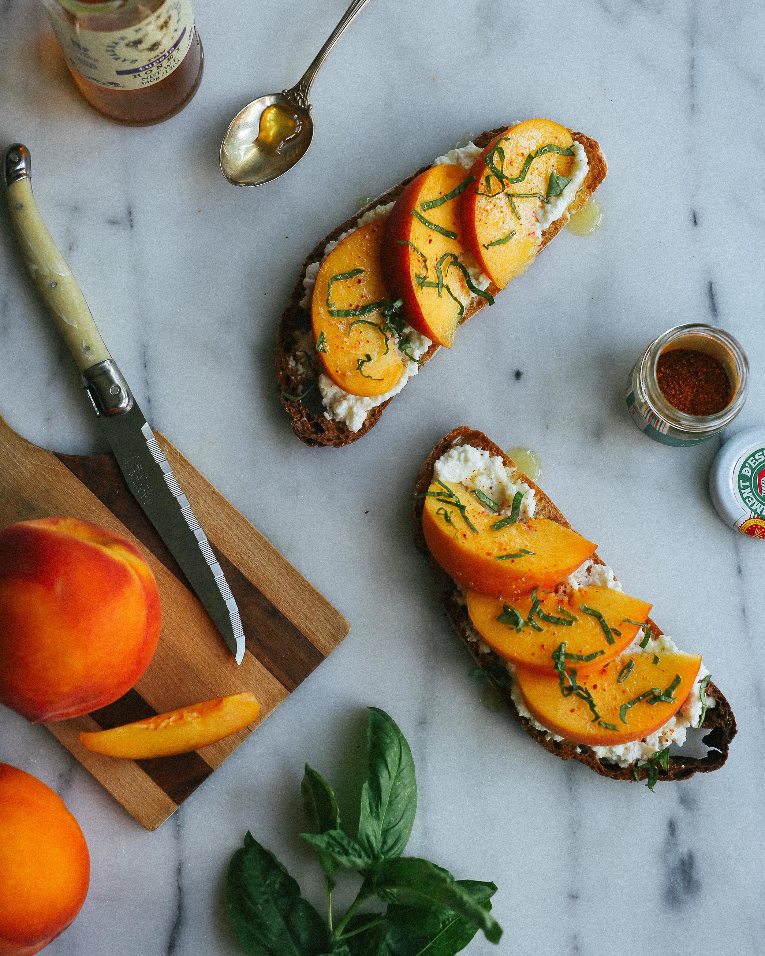 ricotta tartine with peaches, basil, and piment d'espelette