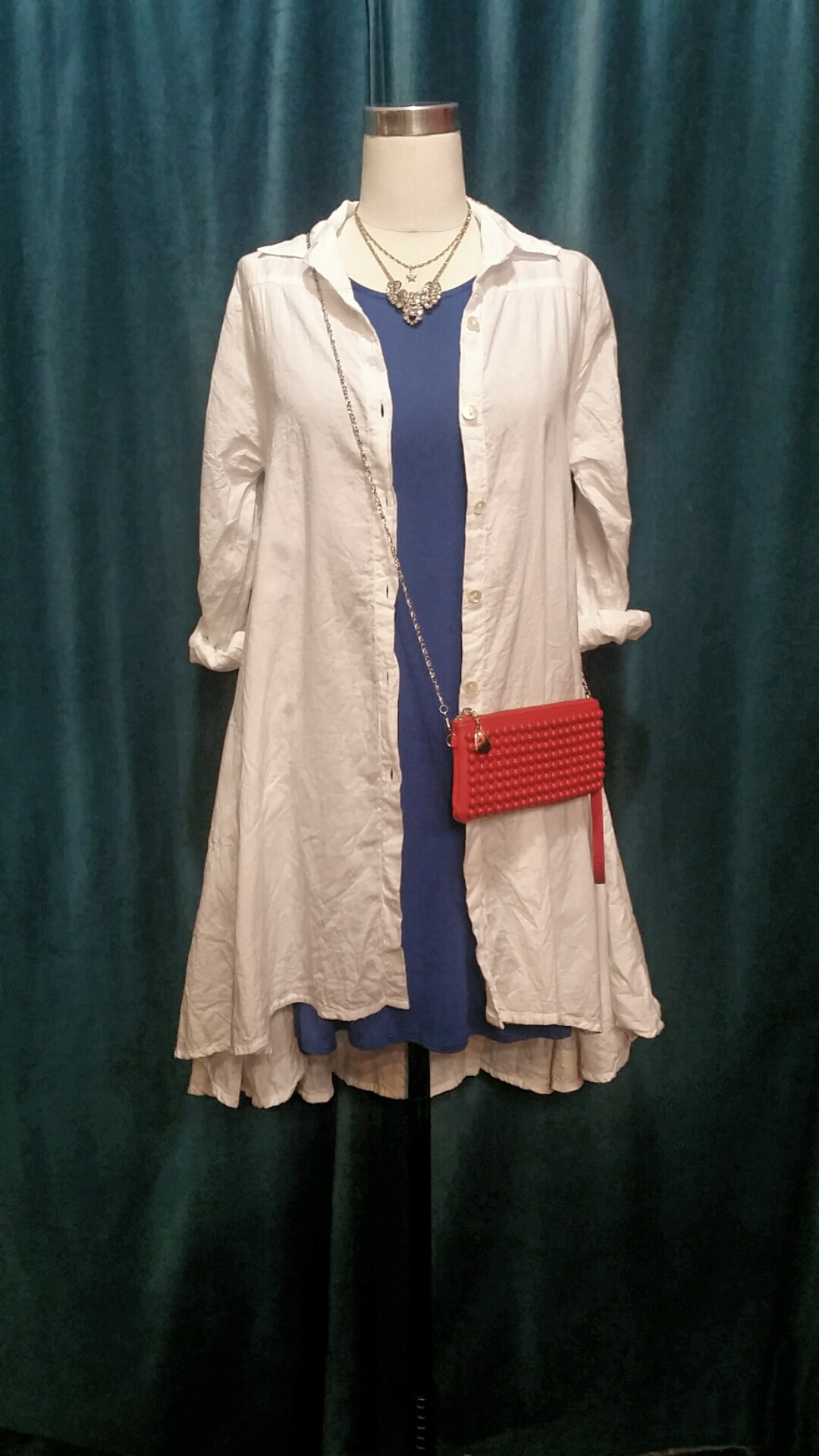 Hourglass Lilly dress, sizes XS/S and S/M, $46. Tulip shirt, sizes XS-L, $114. Red convertible clutch: $28