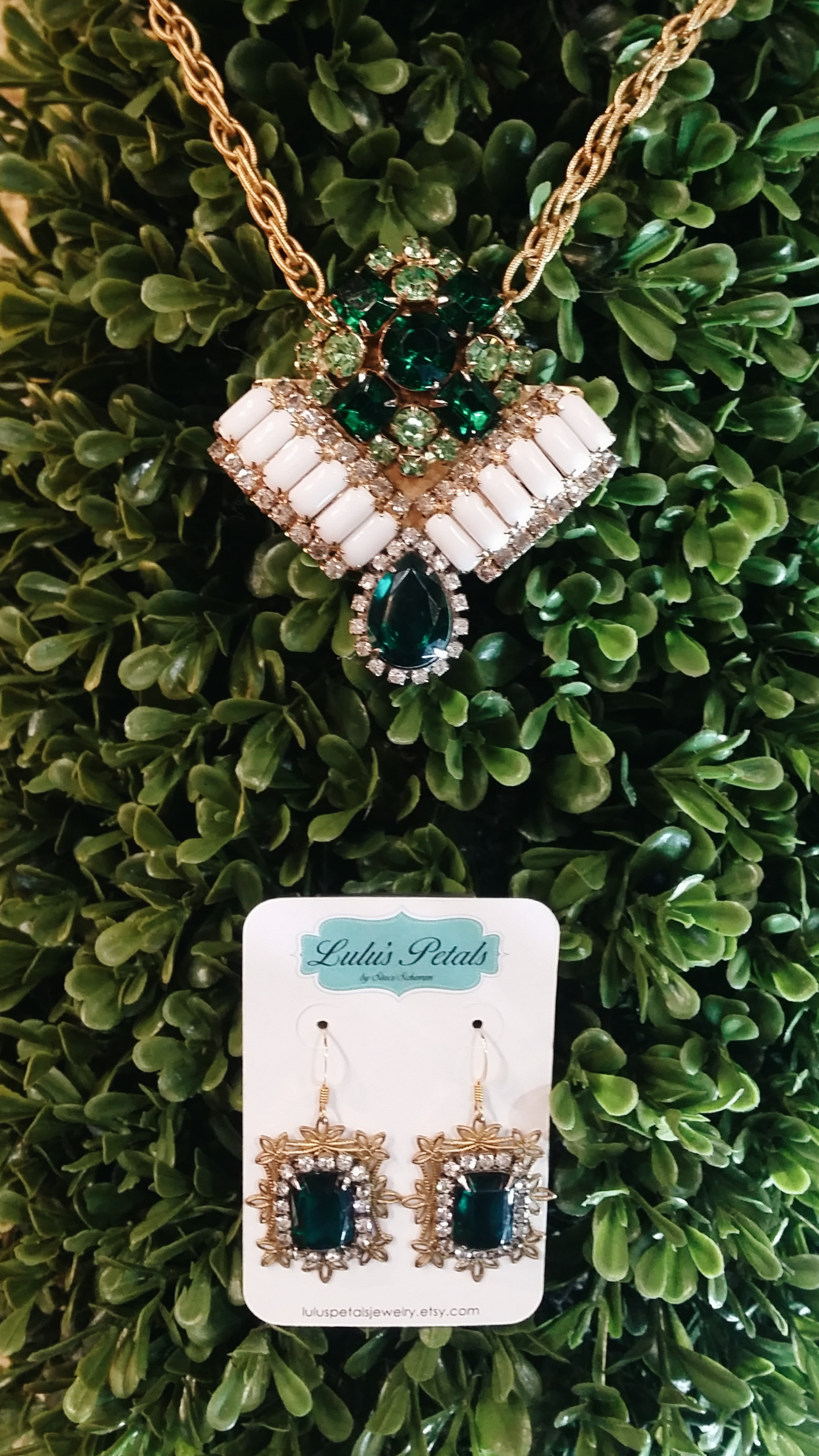 Classic forest green gems and delicate gold metals come together in these coordinating pieces. Necklace: $92. Earrings: $40.