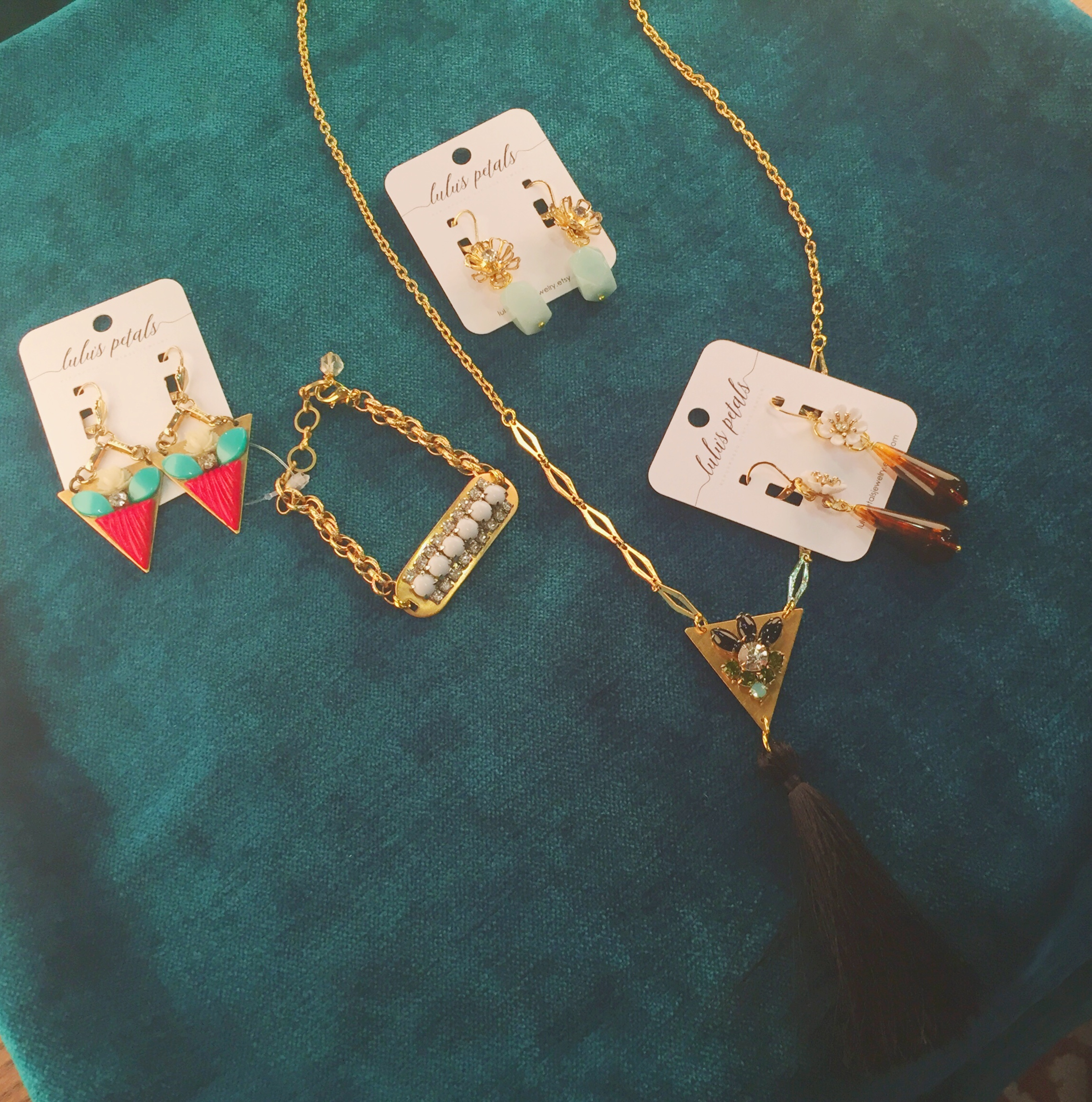 Earrings (from left to right): $42, $32, and $36; bracelet, $42; tassel necklace, $44
