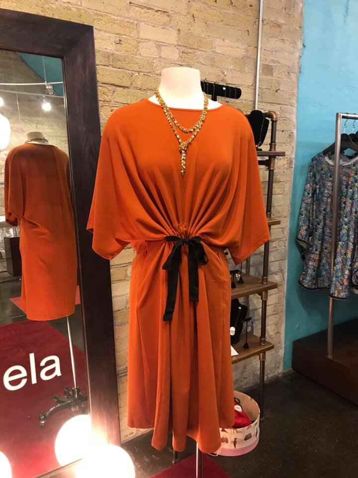 Orange Samual Dong dress. Available in store.