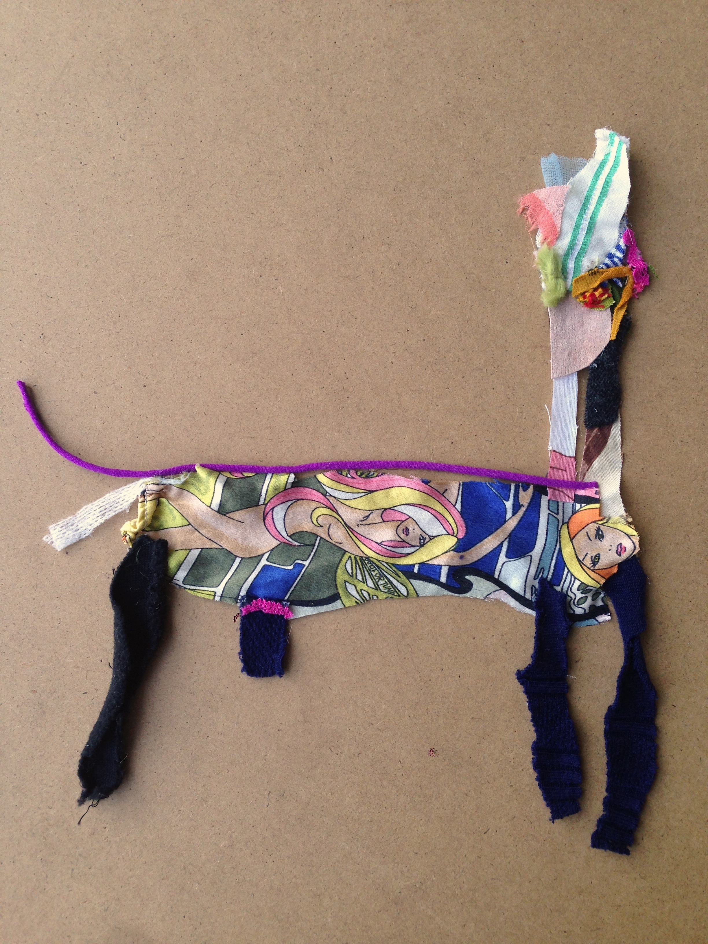 One Sexy Beast (The Narrow Llamalion Who Ate a Lady)  20.5 x 20.5 inches  Recycled fabric: Satin tubing, pink leather mini skirt, my favorite green shirt, antique pink Oscar de la Renta silk scarf, gauze, a slinky summer shirt and knit tights.  2015